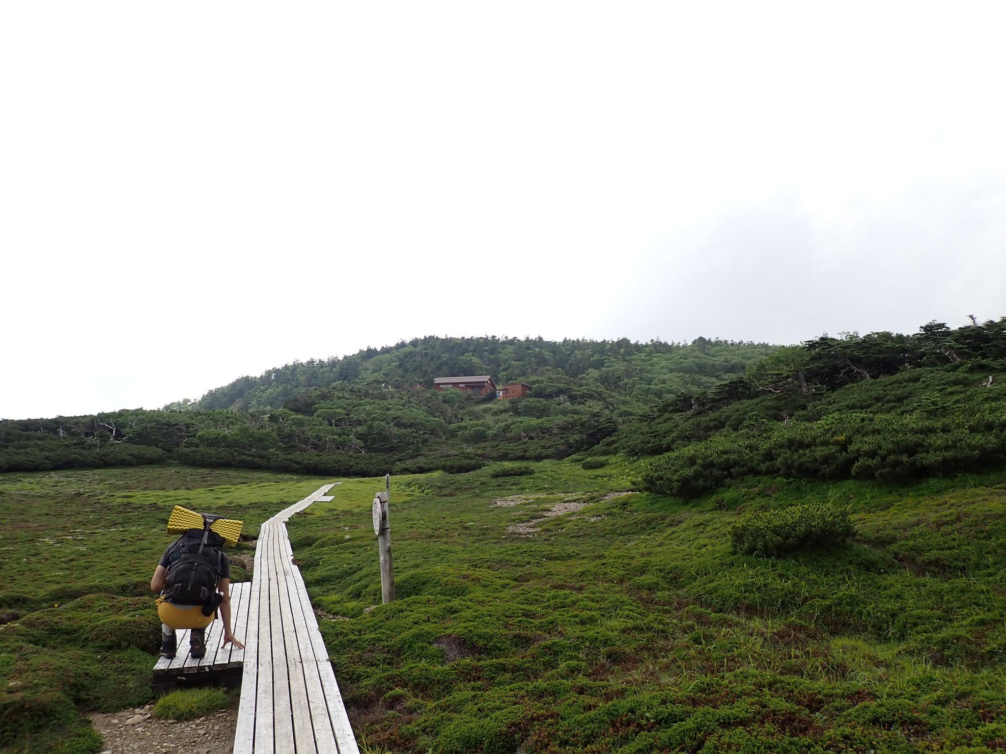 登ること9時間、光小屋が見えた! 感激の瞬間