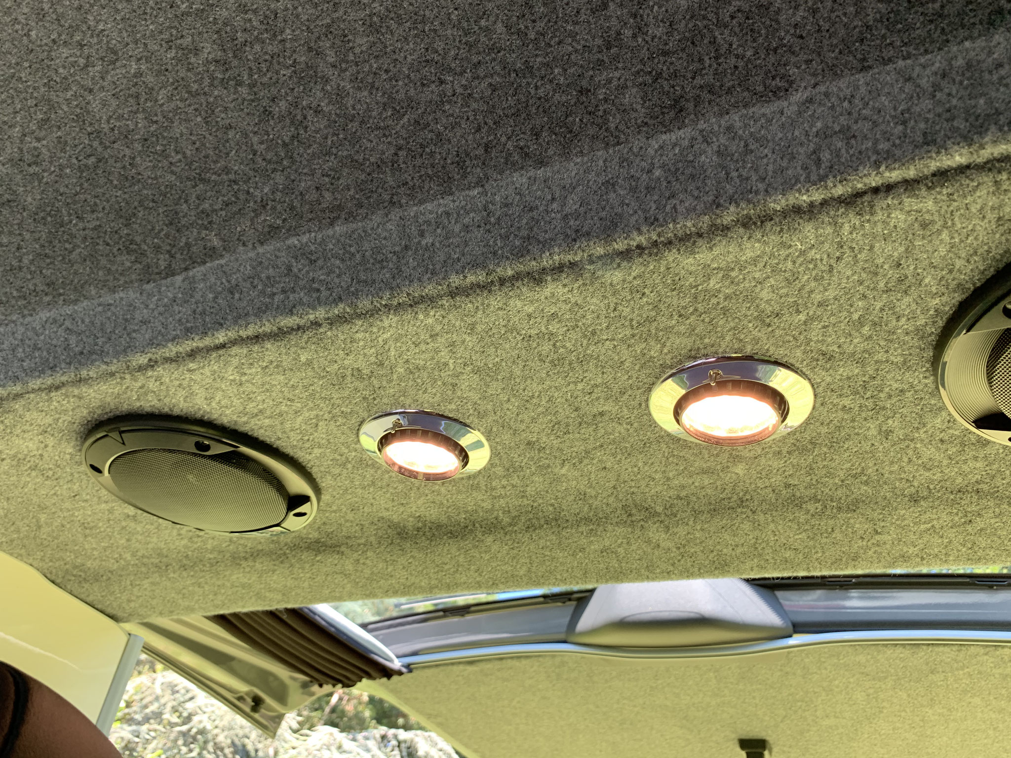 Rear speakers and adjustable reading LED lights