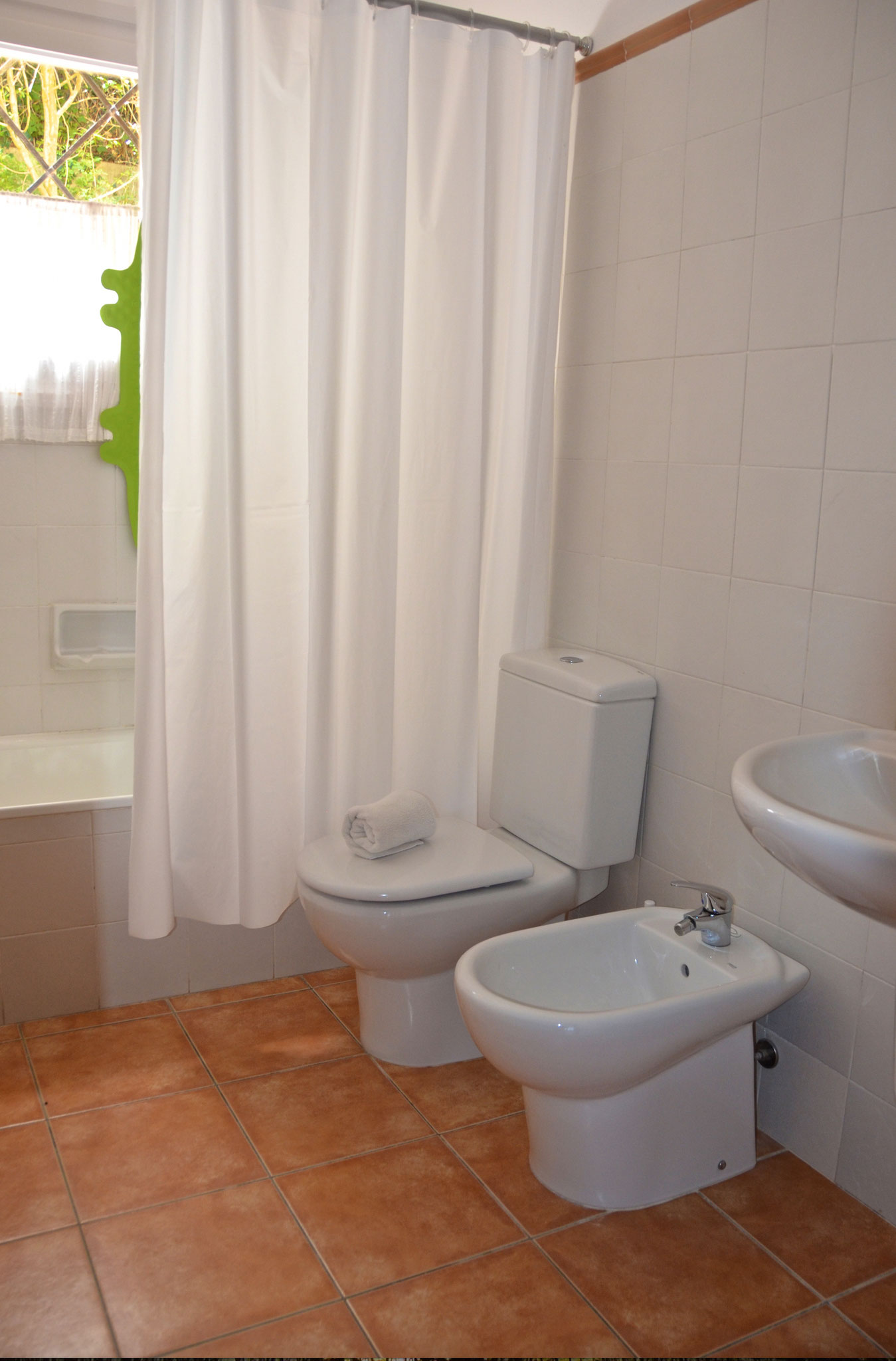 Bathroom with tub/shower convenient to bedrooms 2 & 3