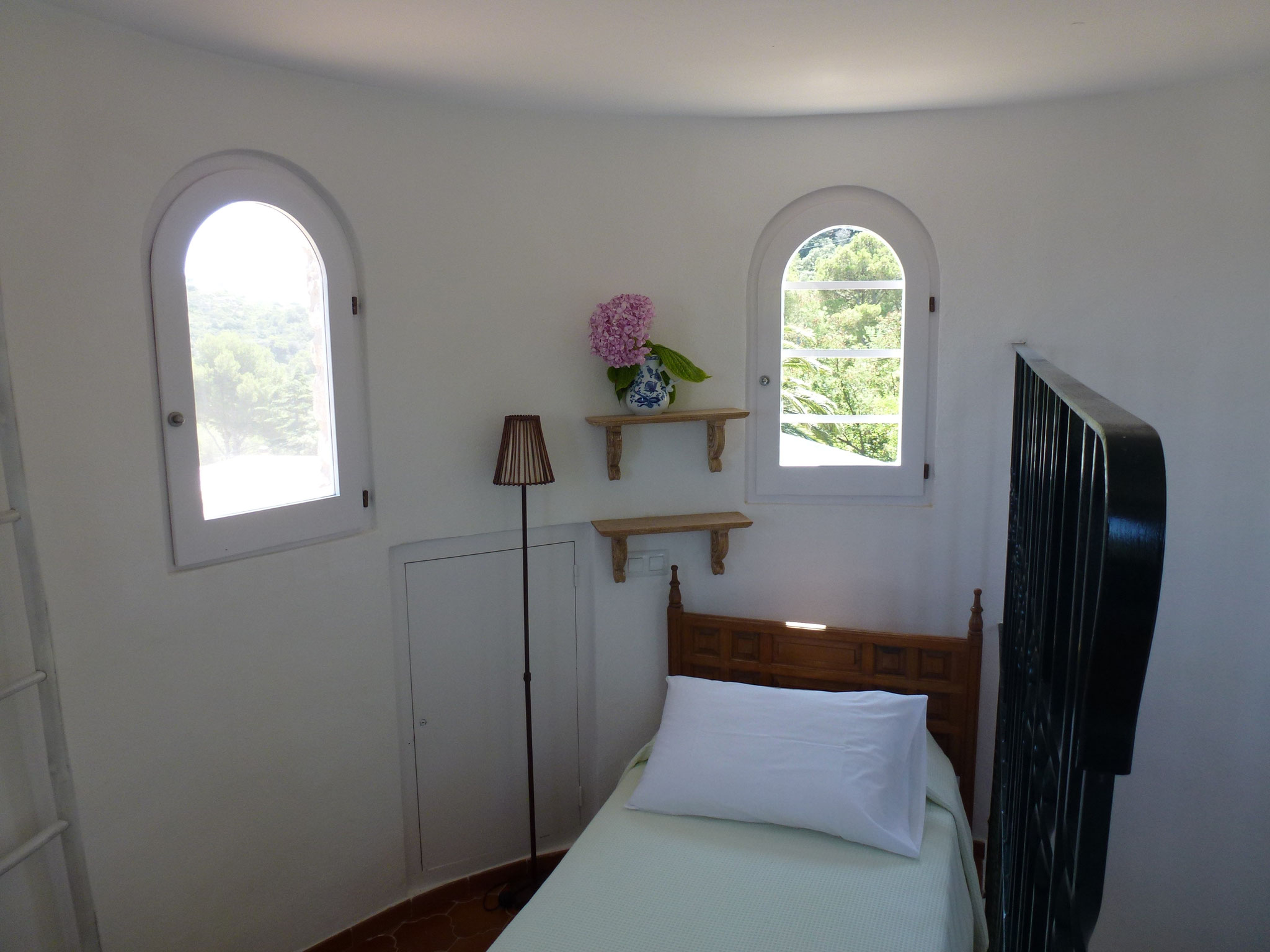 Single bed at the top of the tower