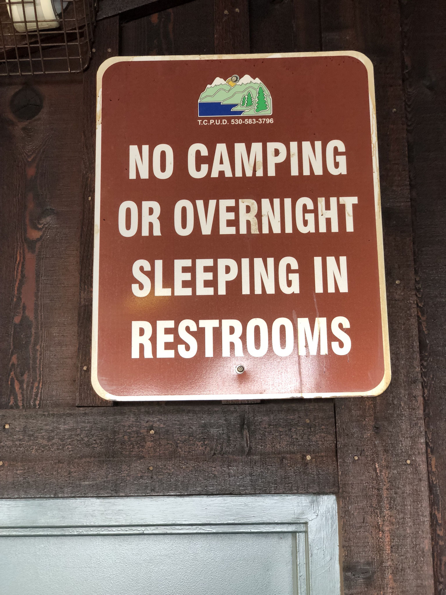Had I not seen this sign I would have never come up with the idea of camping in a toilet