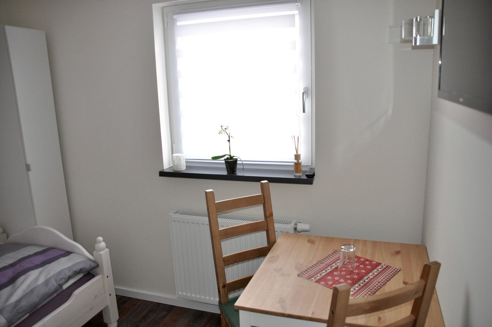 Tisch / Stühle Zimmer 2