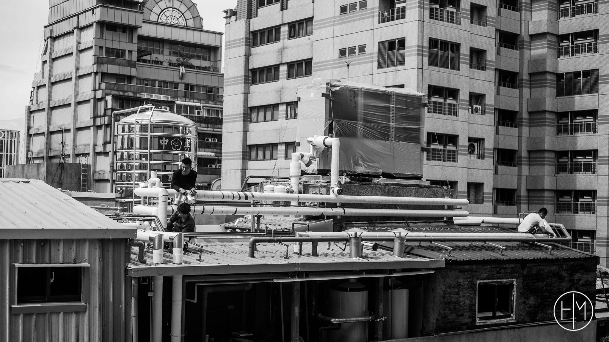 Ouvriers sur un building Taipeih