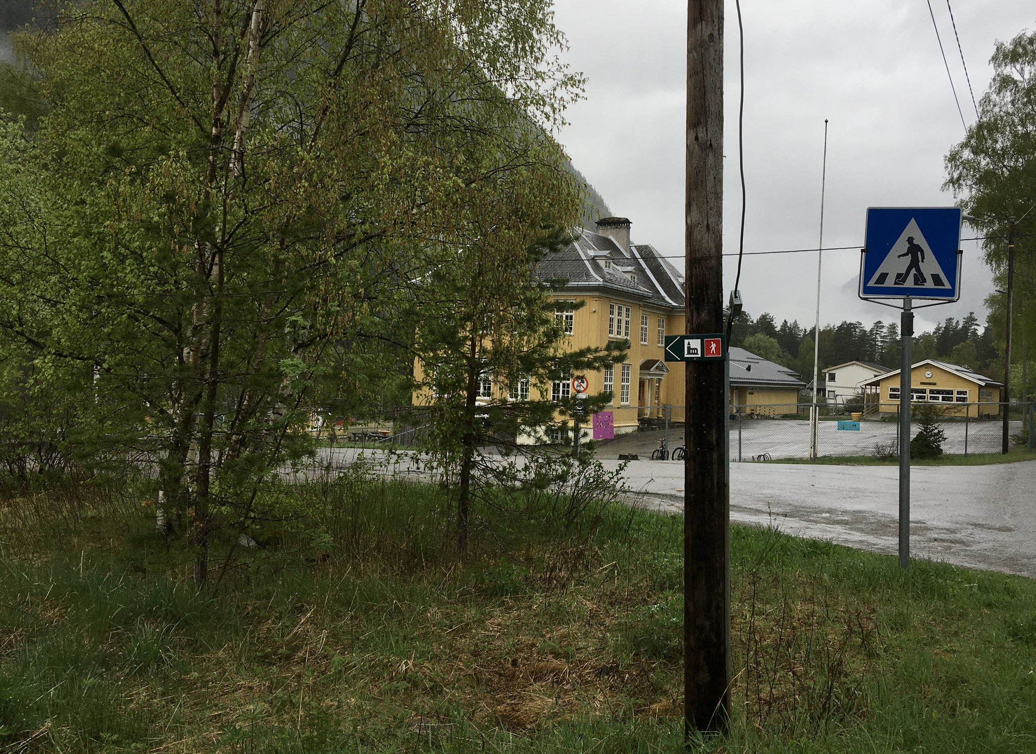 to the left in front of Mæl school