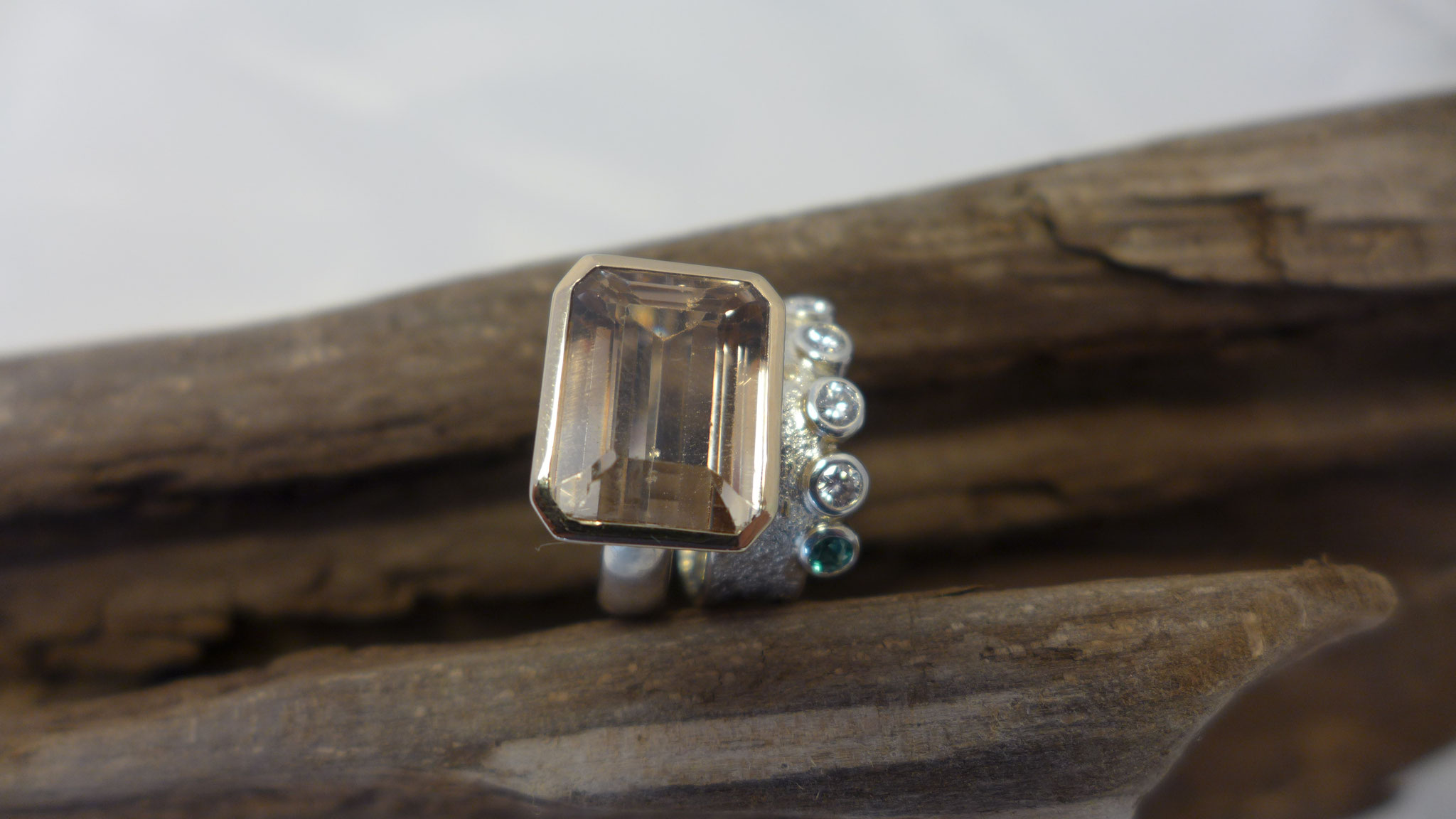 Ring1:Topaz, rose gold, sterling silver Ring two: sterling silver, rose gold dust, diamonds and emerald
