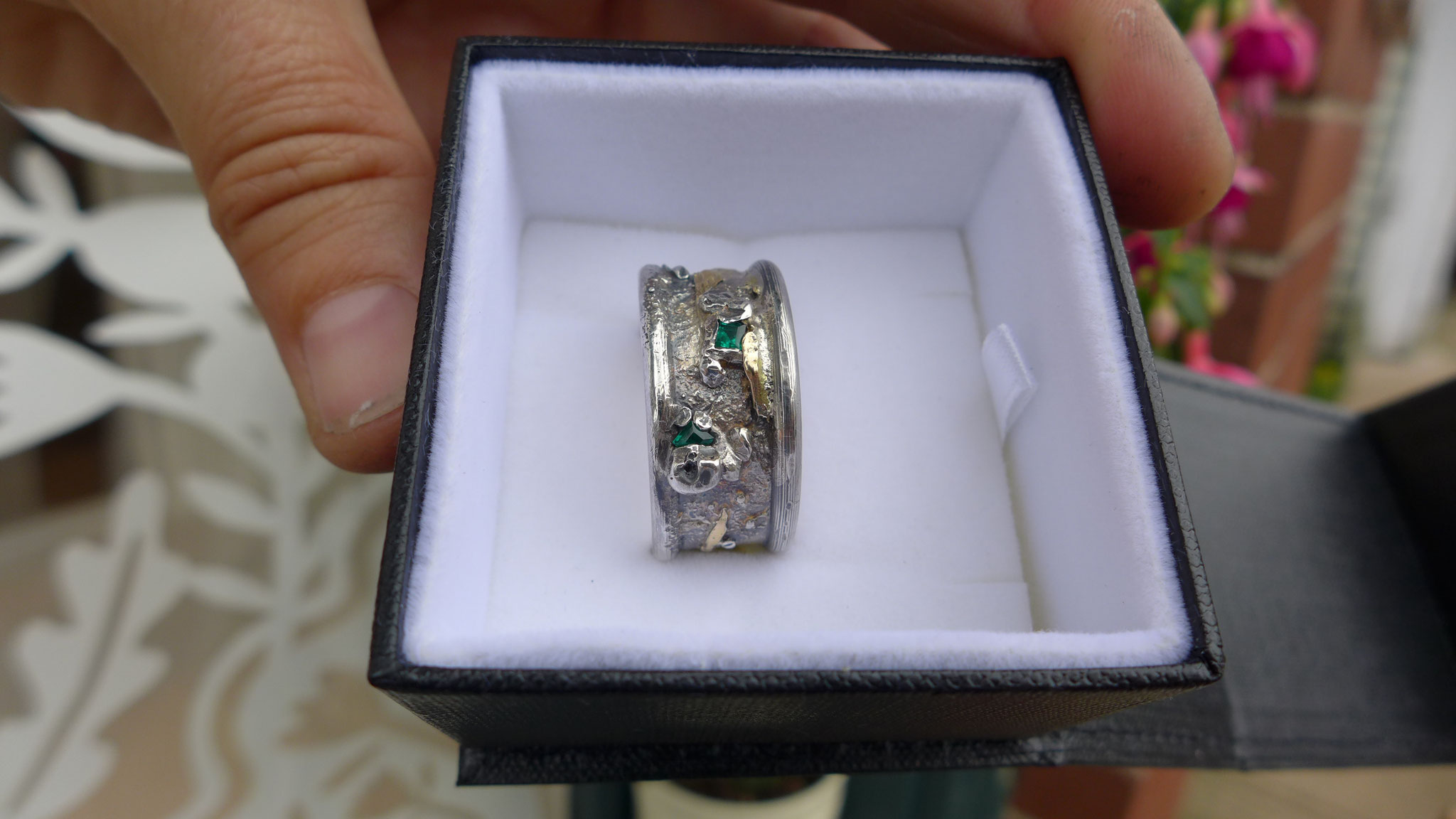 sterling silver, gold, emeralds