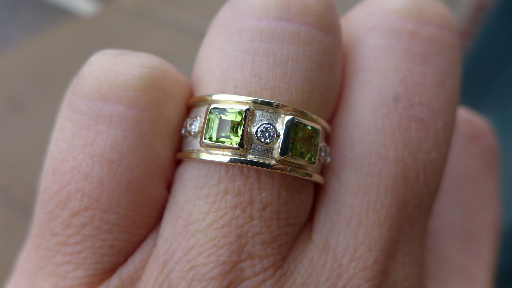 14k white and yellow gold, diamonds, peridots