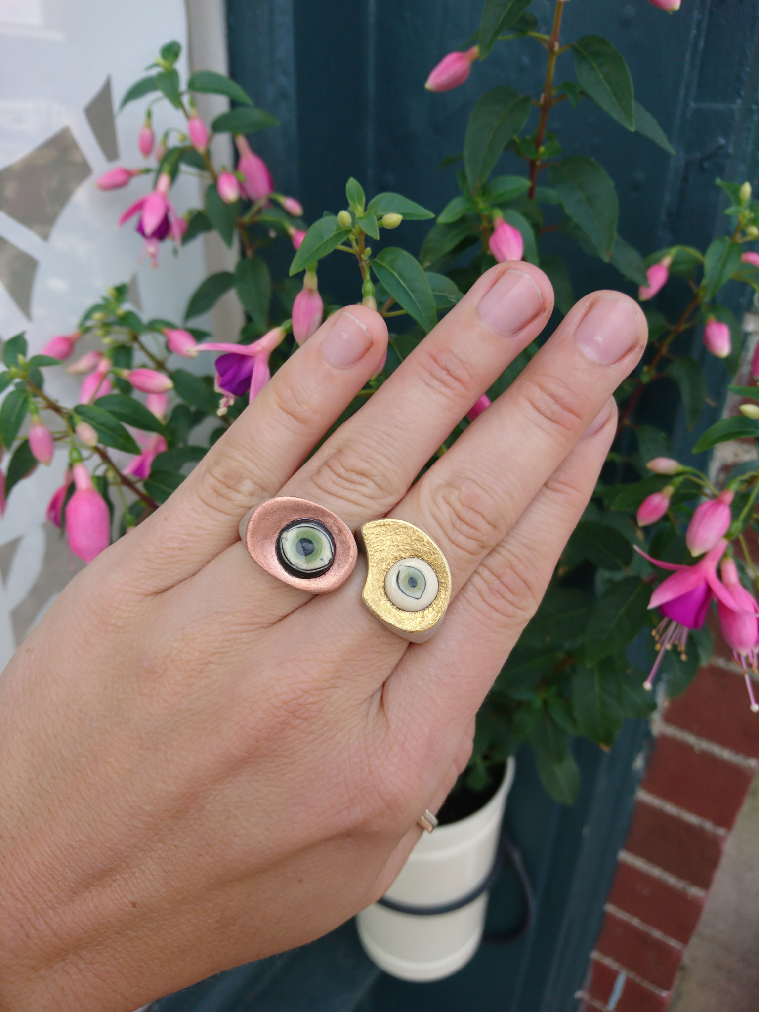 silver, cupper, 24k gold and ceramic eyes