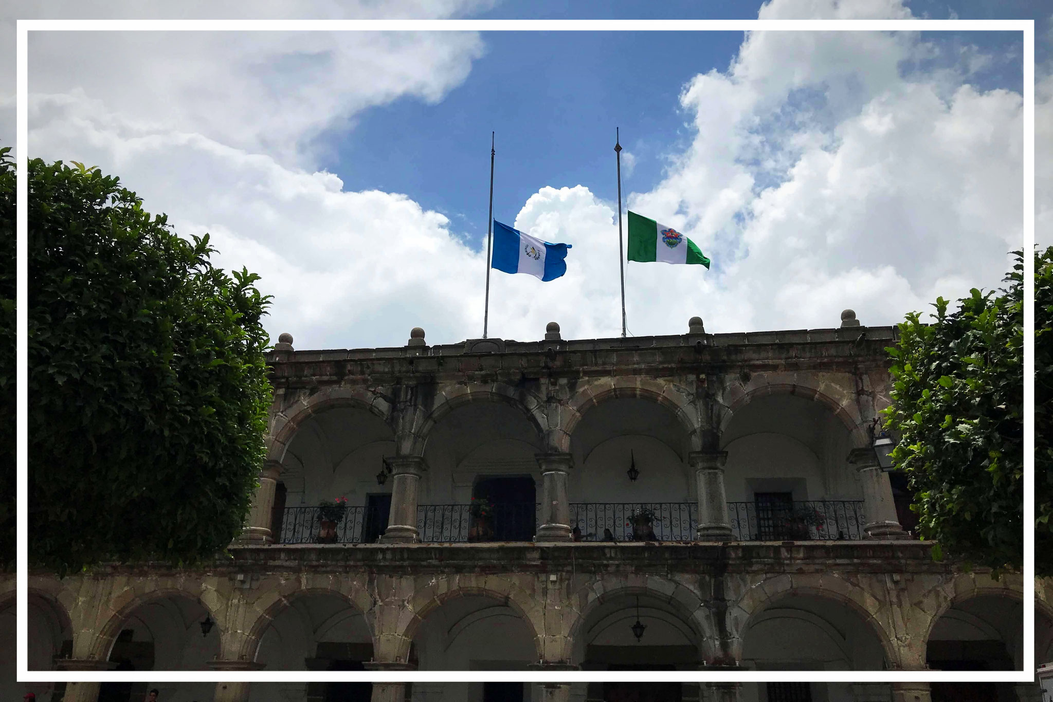 ... in commemoration of the victims blow flags at half-mast on the Palacio del Ayuntamiento
