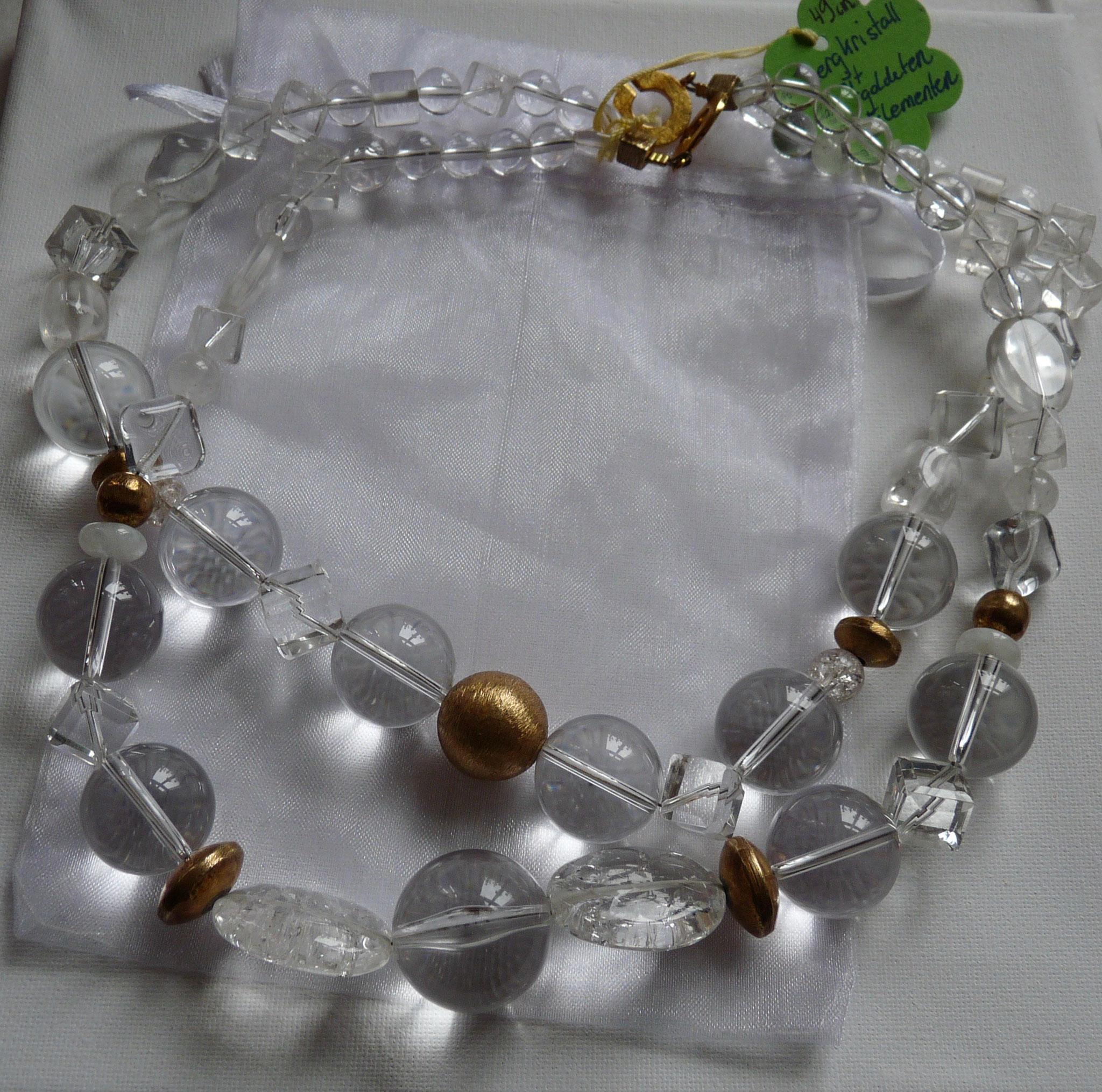 Bergkristall mit vergoldeten Elementen