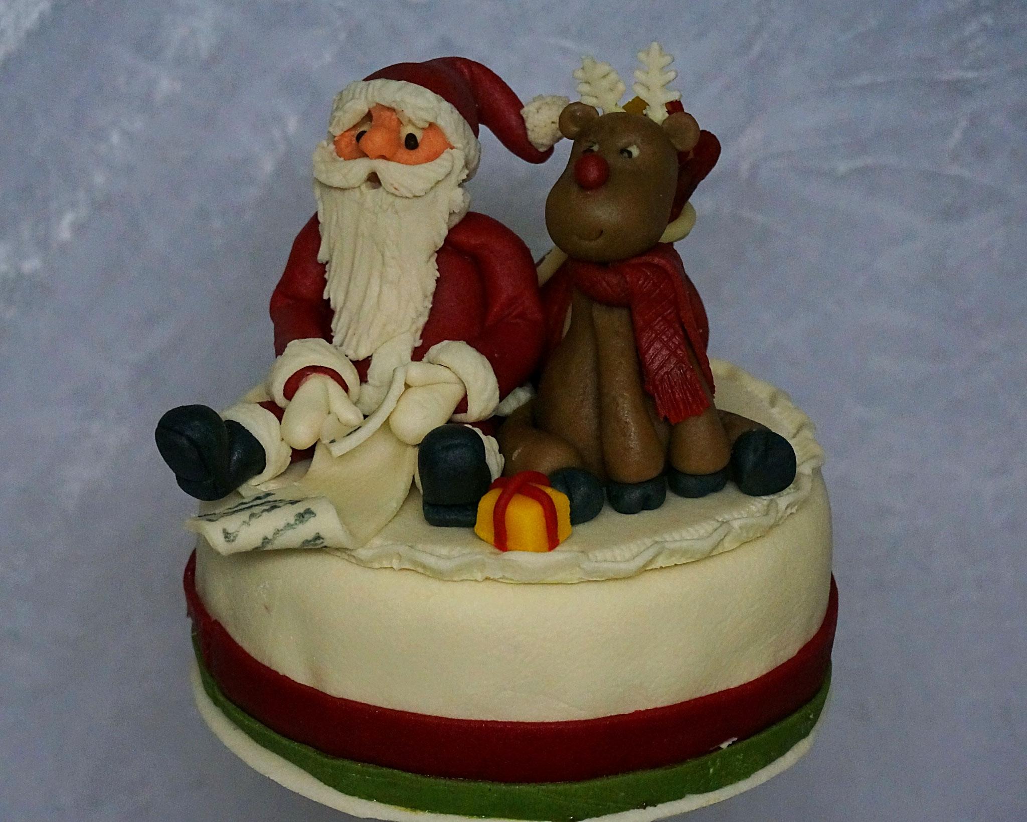 Tortendekor Weihnachtsmann mit Rentier