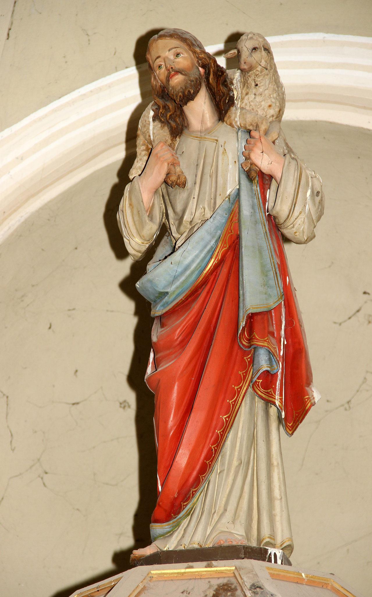 Christus der gute Hirte über dem Schalldeckel der Kanzel