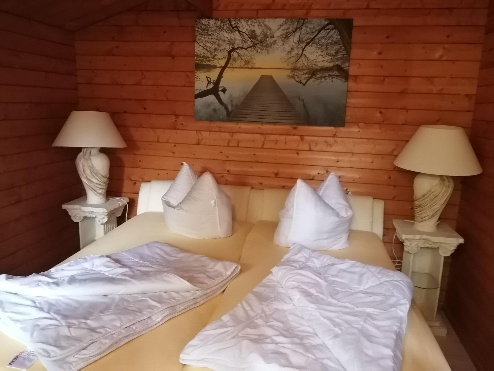 Blockhaus mit Doppelbett