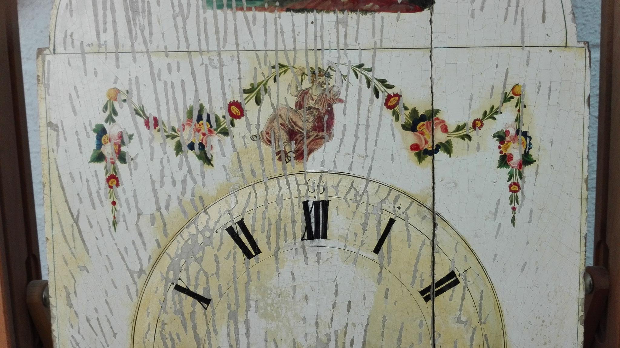 Esfera de reloj alemán. Pintura sobre tabla.  Limpieza. Eliminación de barniz oxidado y repintes.