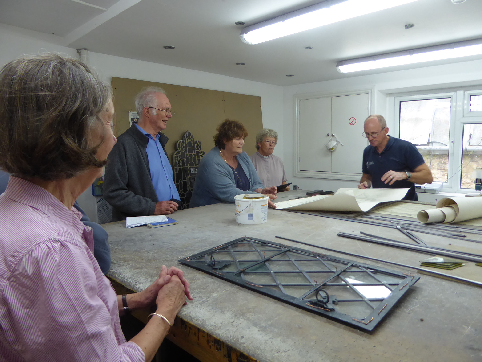 A group from the Village visits Heritage Glass to see renovation in progress
