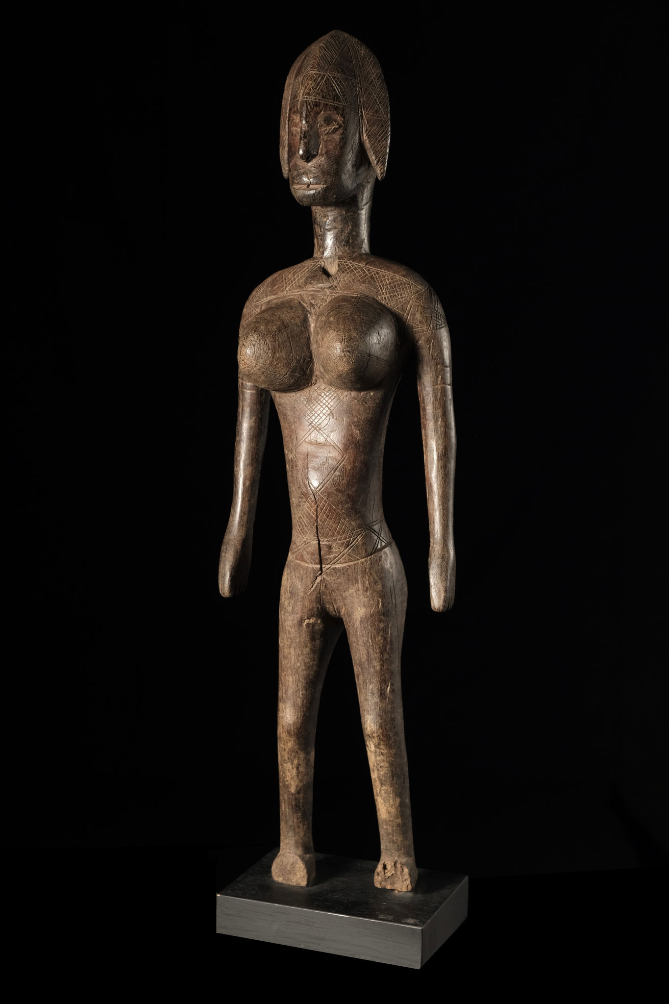 Bambara Figure with fine scarification and shiny patina.