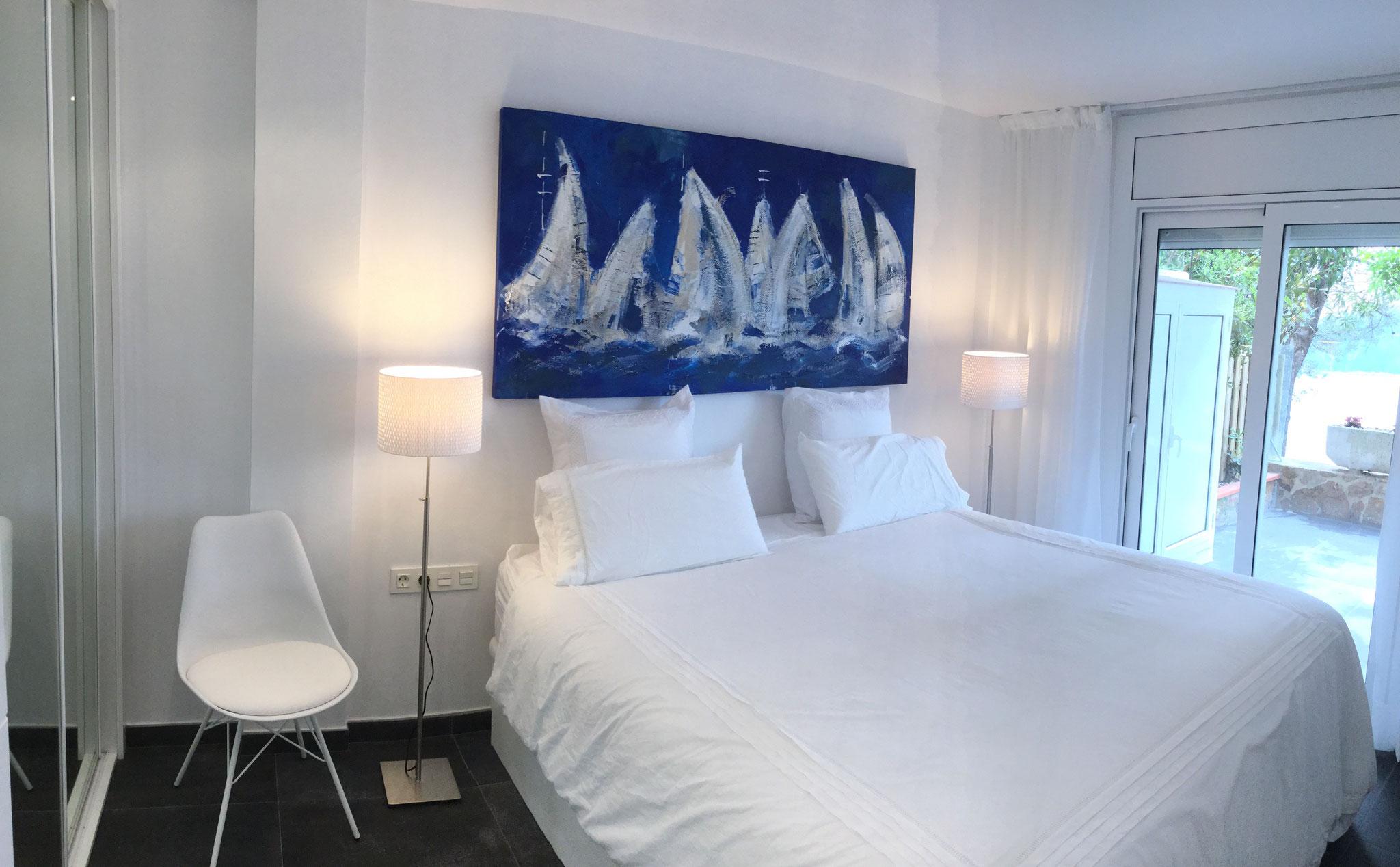 Dormitori de matrimoni amb llit de 180x200
