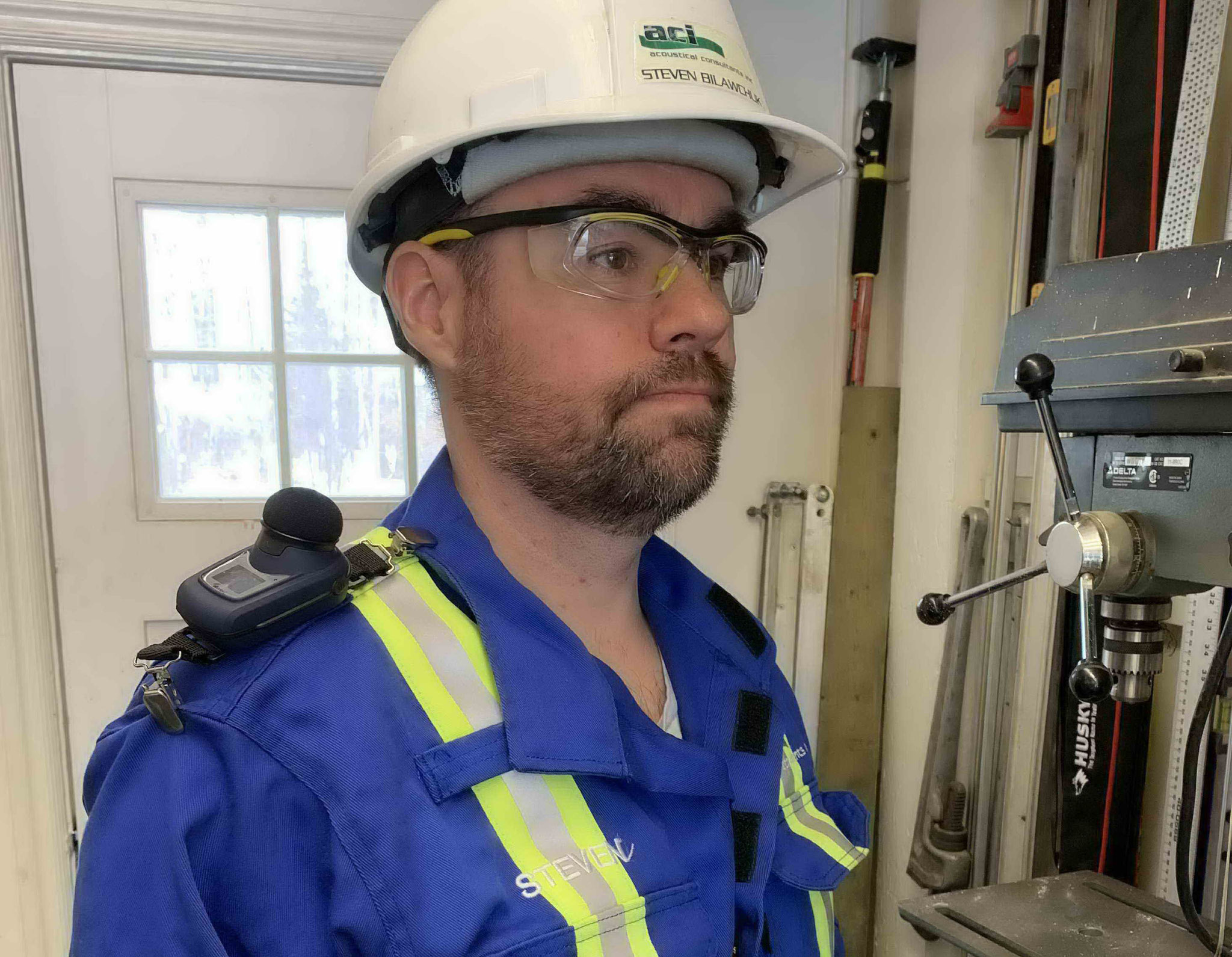 Worker Wearing Noise Dosimeter