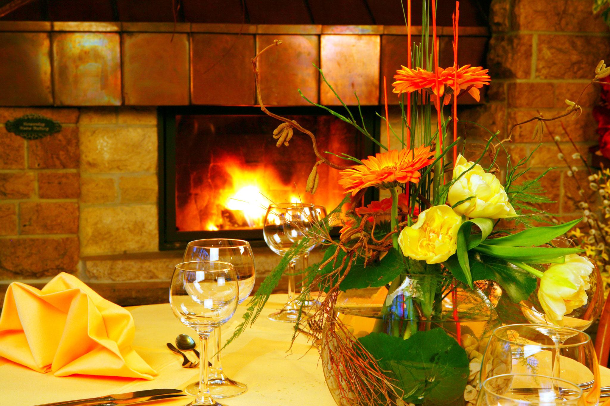 Kaminfeuer im Wintergarten