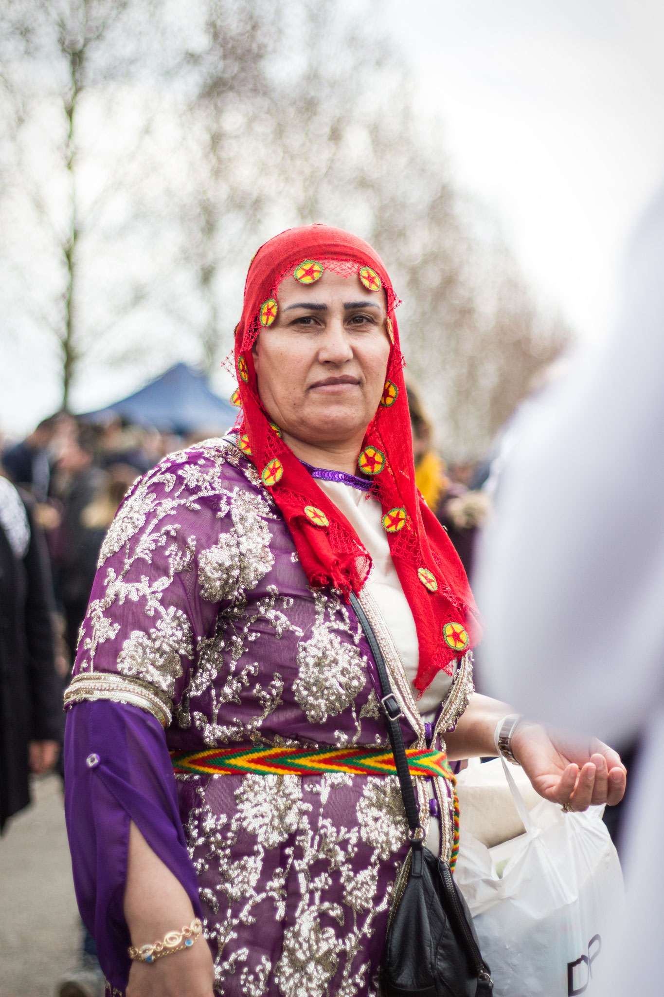 Woman in traditional Kurdish gown, celebrating the new year during Newroz in London's Finsbury Park, March 2018.