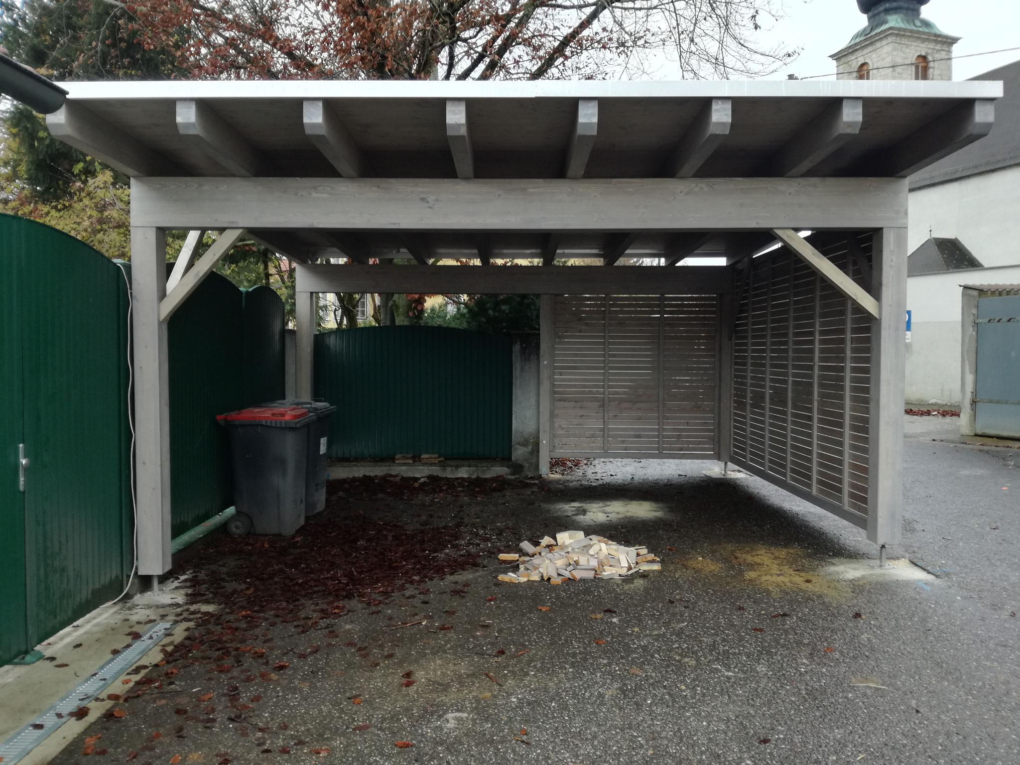 Doppelcarport mit Sichtschutzwand und Resitrik Dacheindeckung