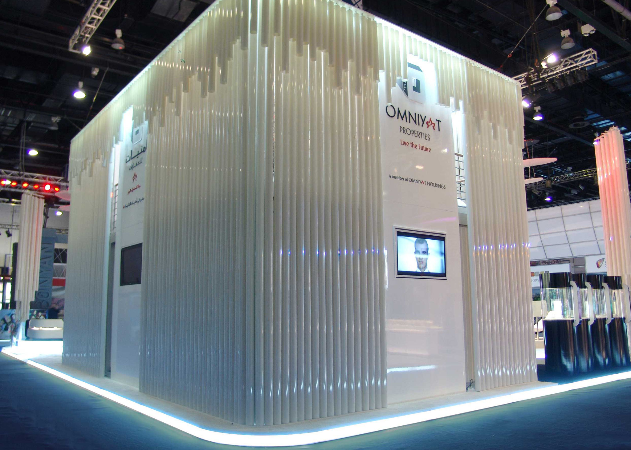 Exhibition stand with illuminated tubes