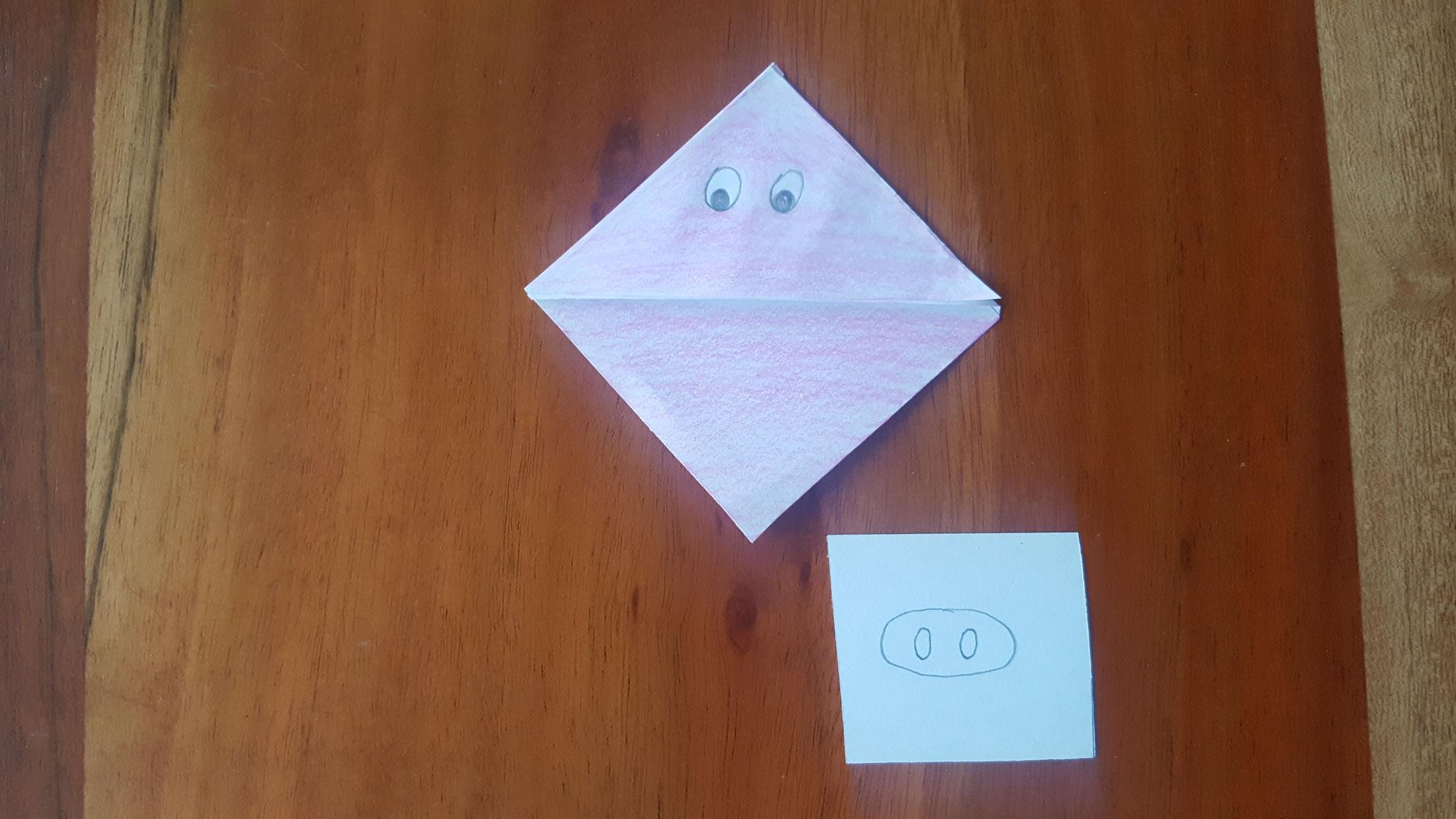 Das Lesezeichen rosa angemalt, Augen aufgemalt und die Nase vorgezeichnet