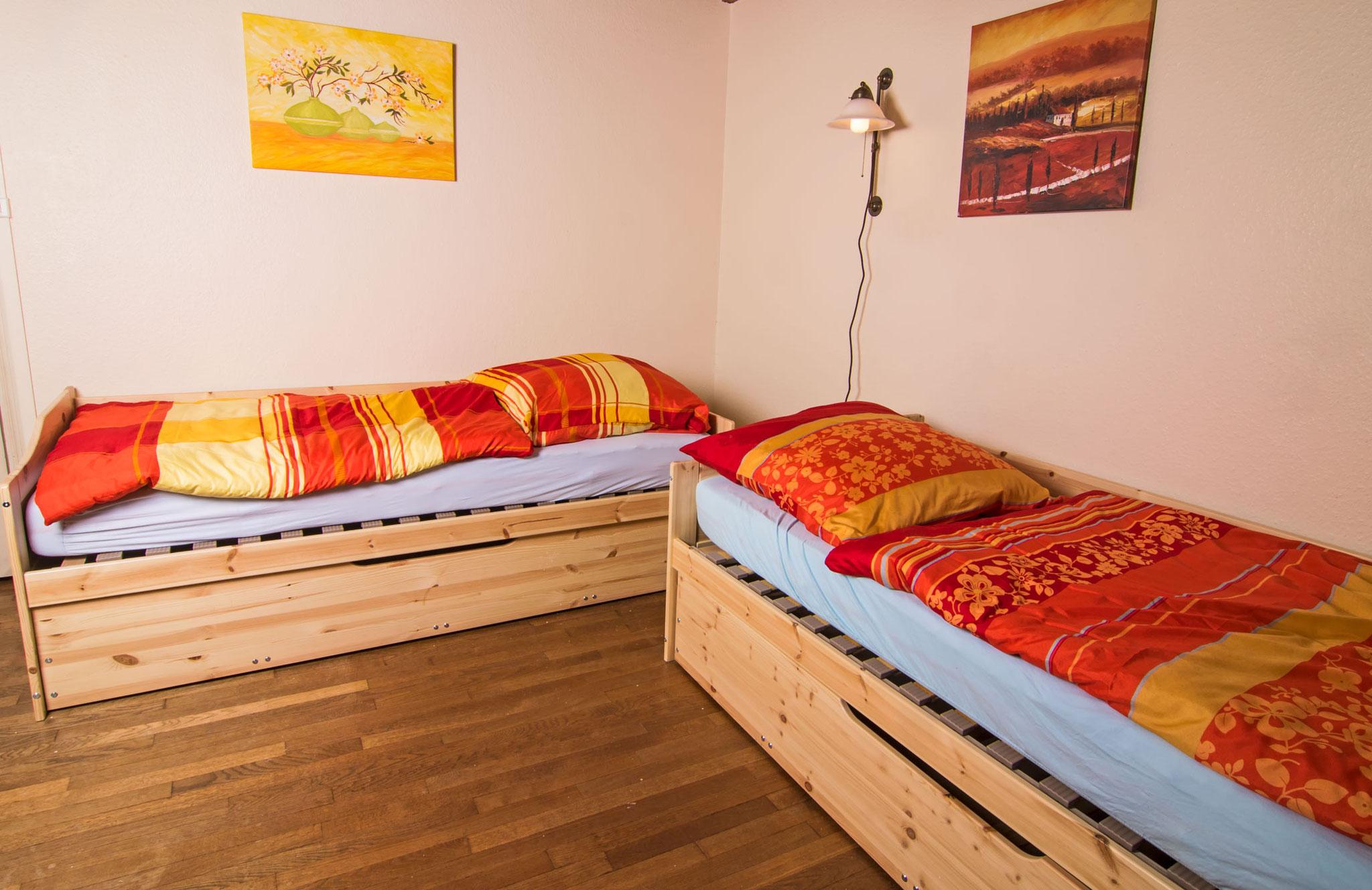 Im dritten Schlafzimmer stehen zwei Einzelbetten, die auch zusammengeschoben werden können