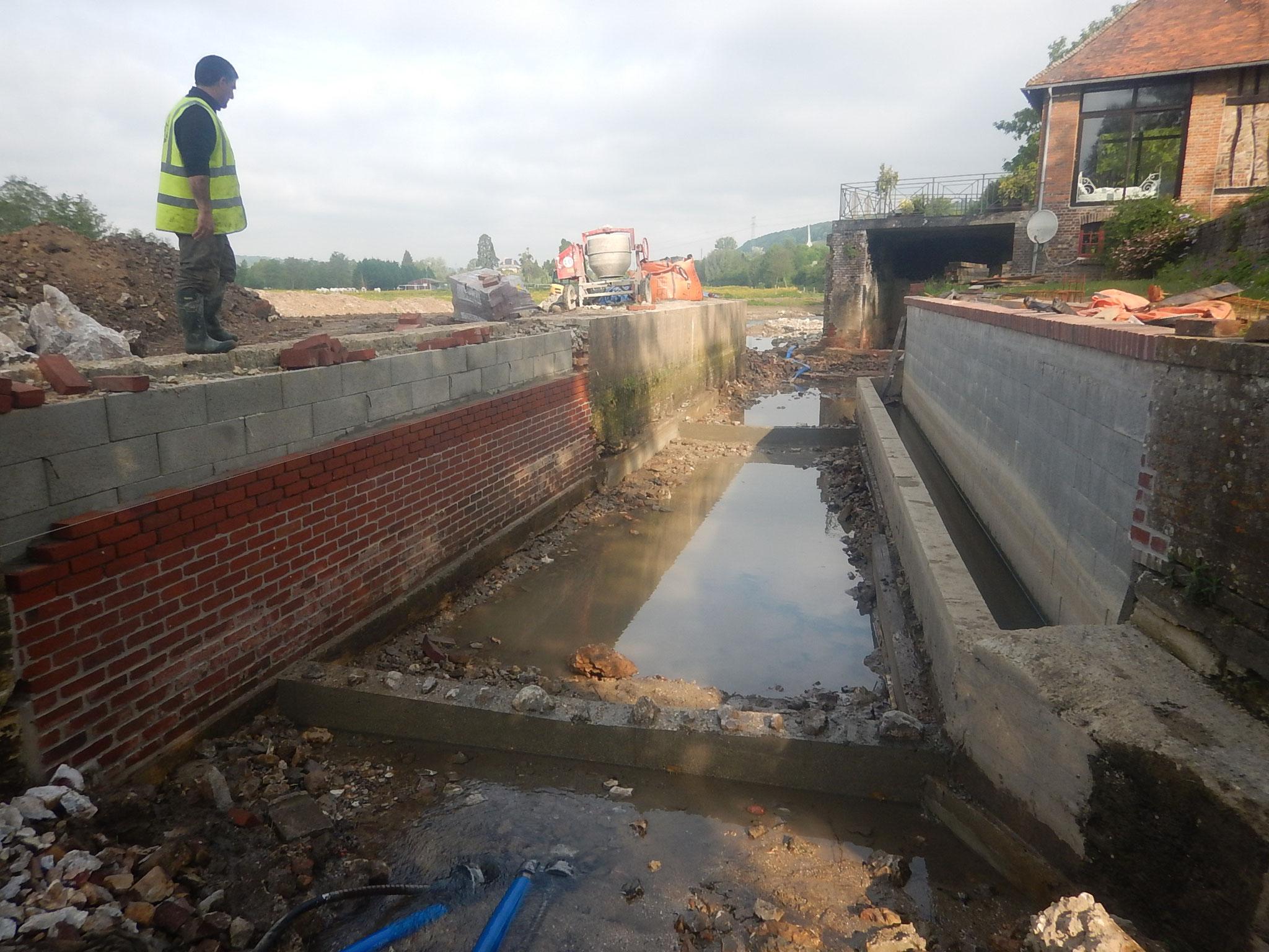 Restauration des fondations et consolidation des maçonneries.