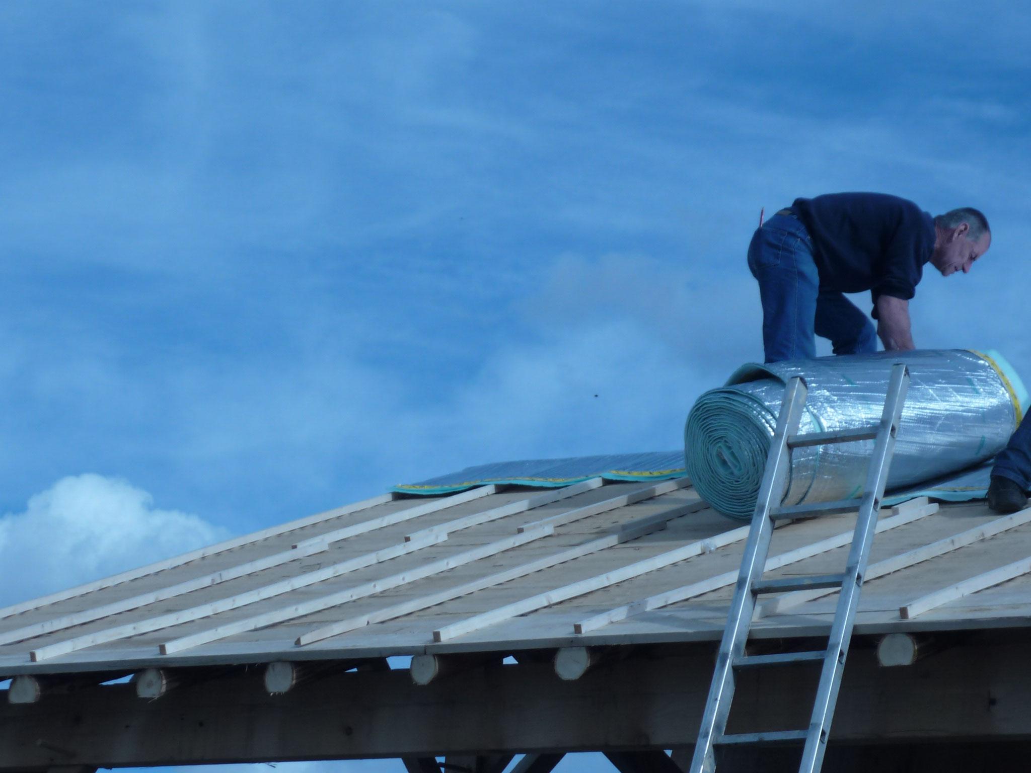 Pose de l'isolant toiture