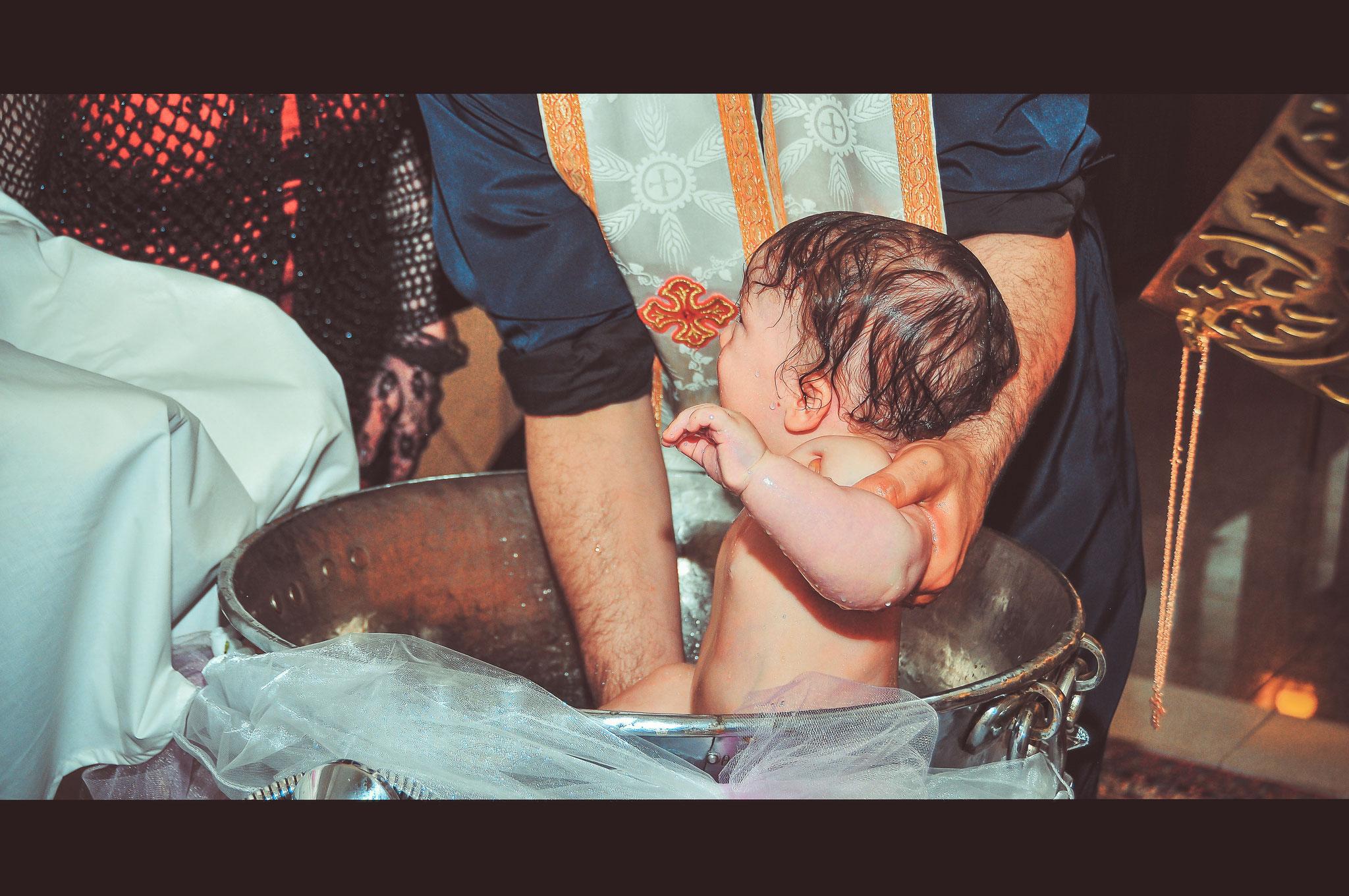 Detailaufnahmen einer Taufe