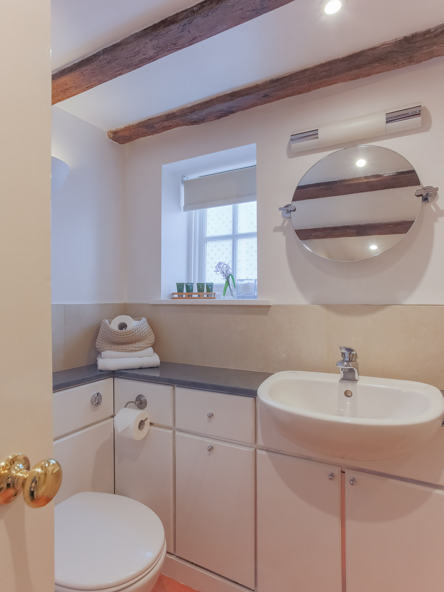 The bathroom has plenty of storage and counter space