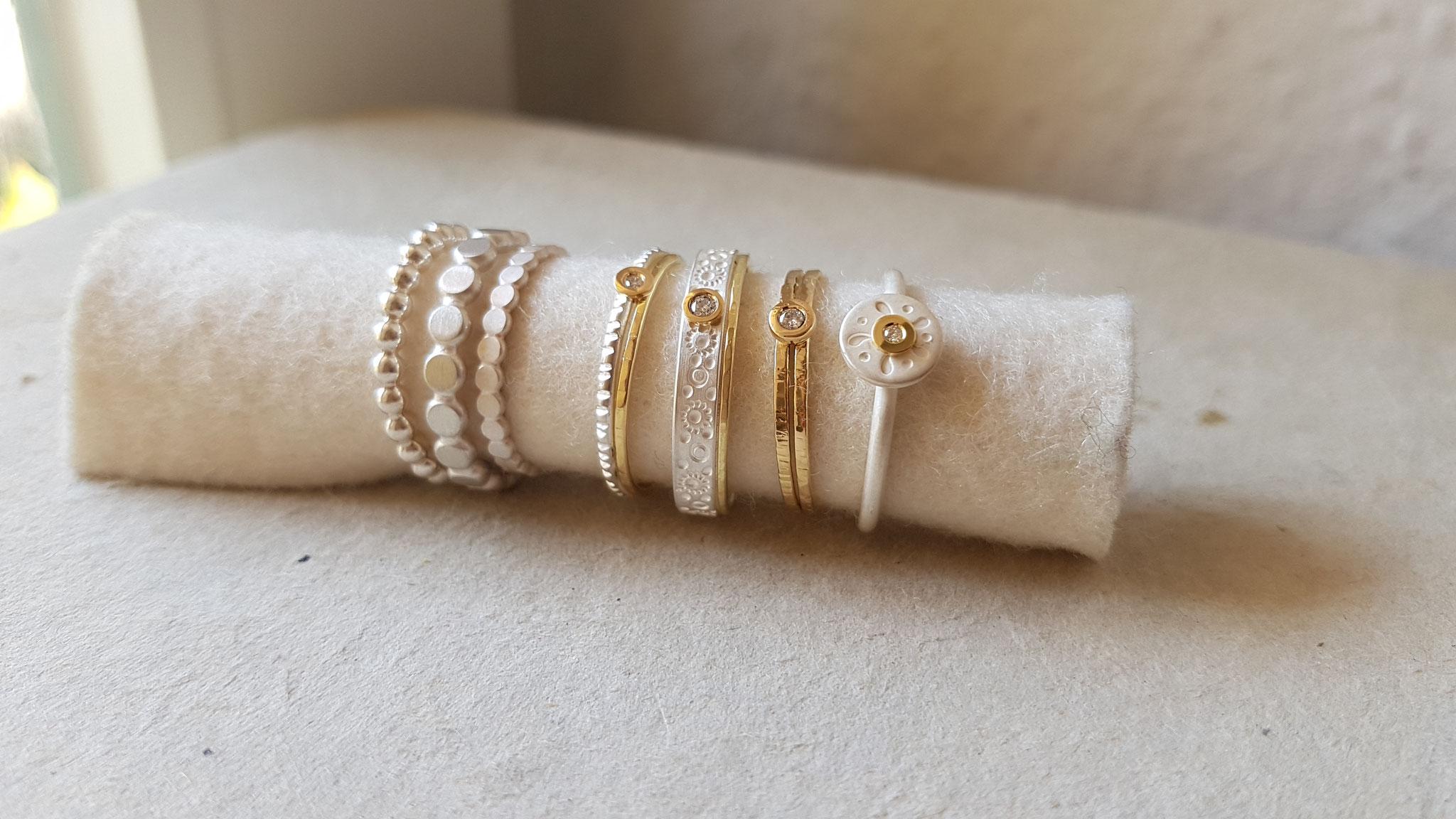 Ringe in Silber 925, weißgesiedet, mit Gelbgold 750, Brillanten