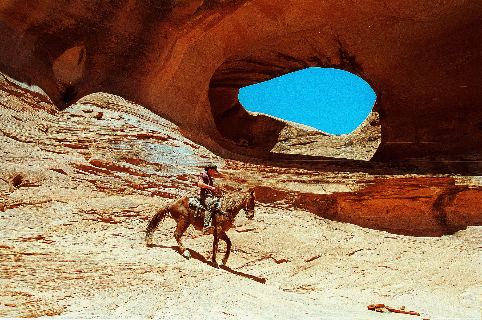 © Hans G. Lehmann |  Cowboy on horseback  in Monument Valley