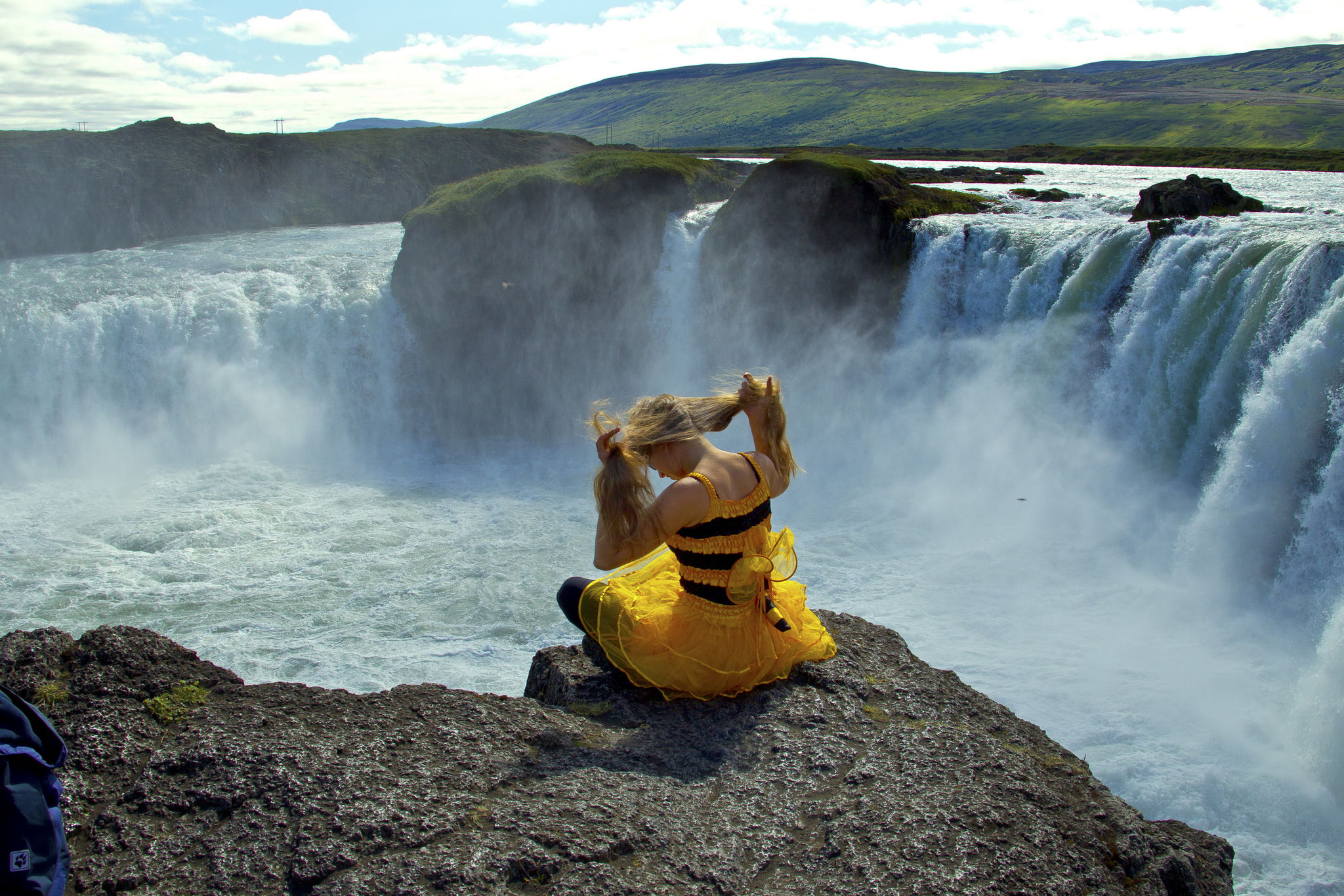 © Hans G. Lehmann | Maja the Bee on the rim of waterfall Godafoss, Iceland