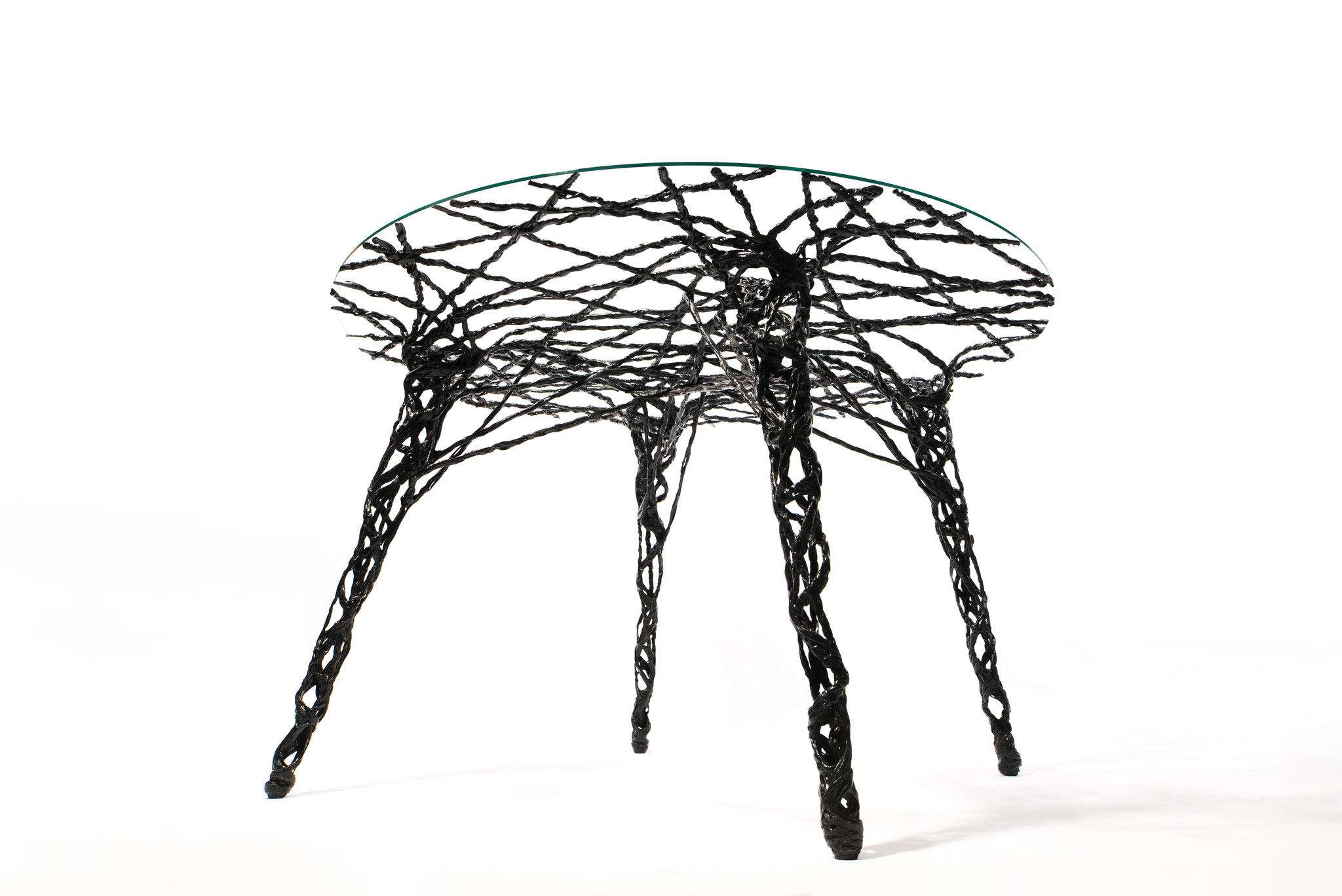 Constructive expressionism table, made out of carbon fiber and epoxy resin, H: 75 cm, W: 125cm, L: 125cm