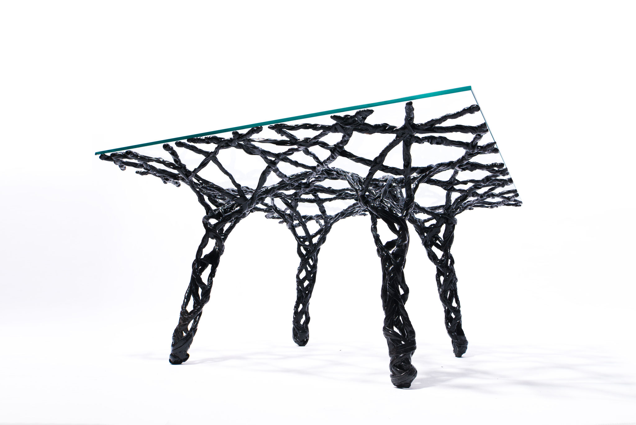Constructive expressionism side table, made out of carbon fiber and epoxy resin, H: 40cm, W: 81cm, L: 81cm