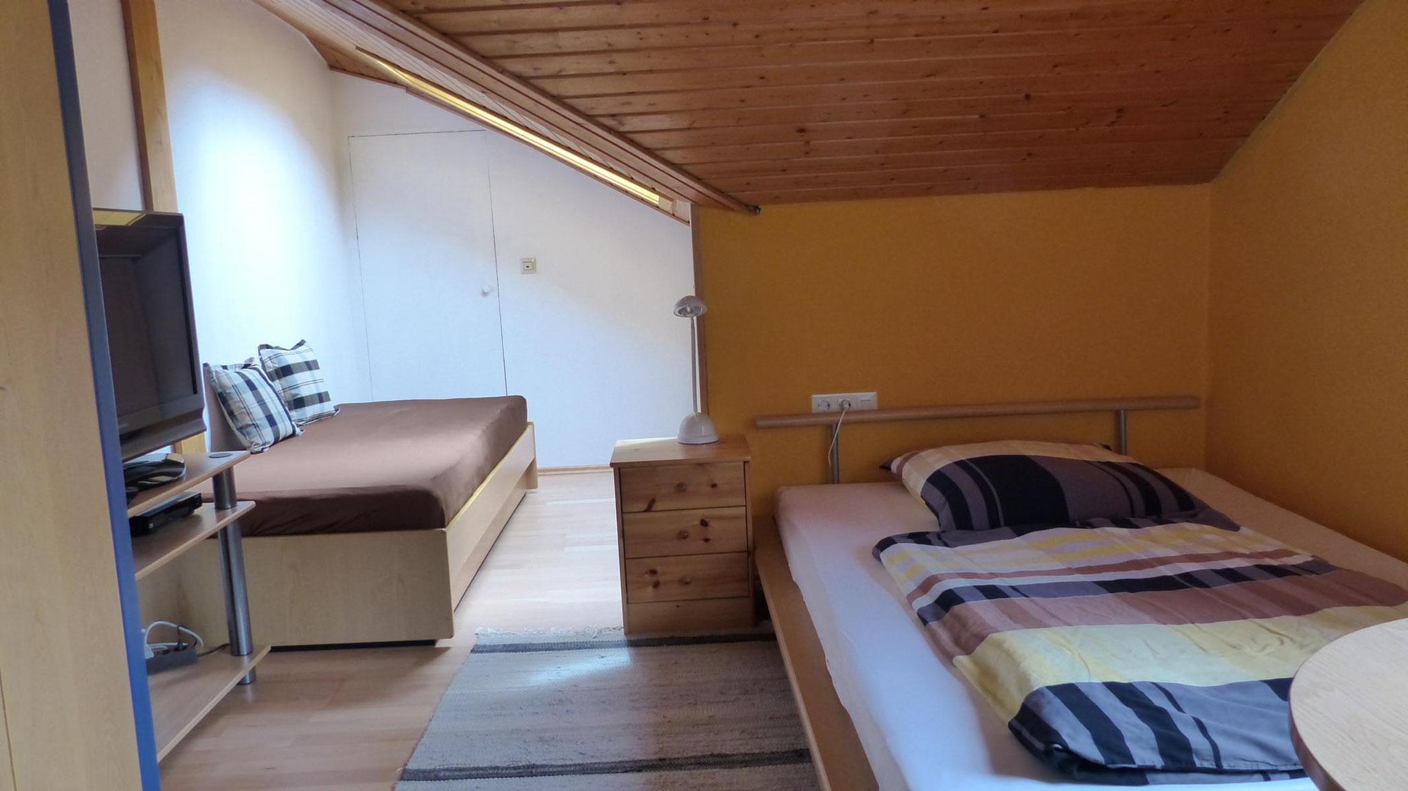 1 Schlafzimmer mit 2 Einzelbetten