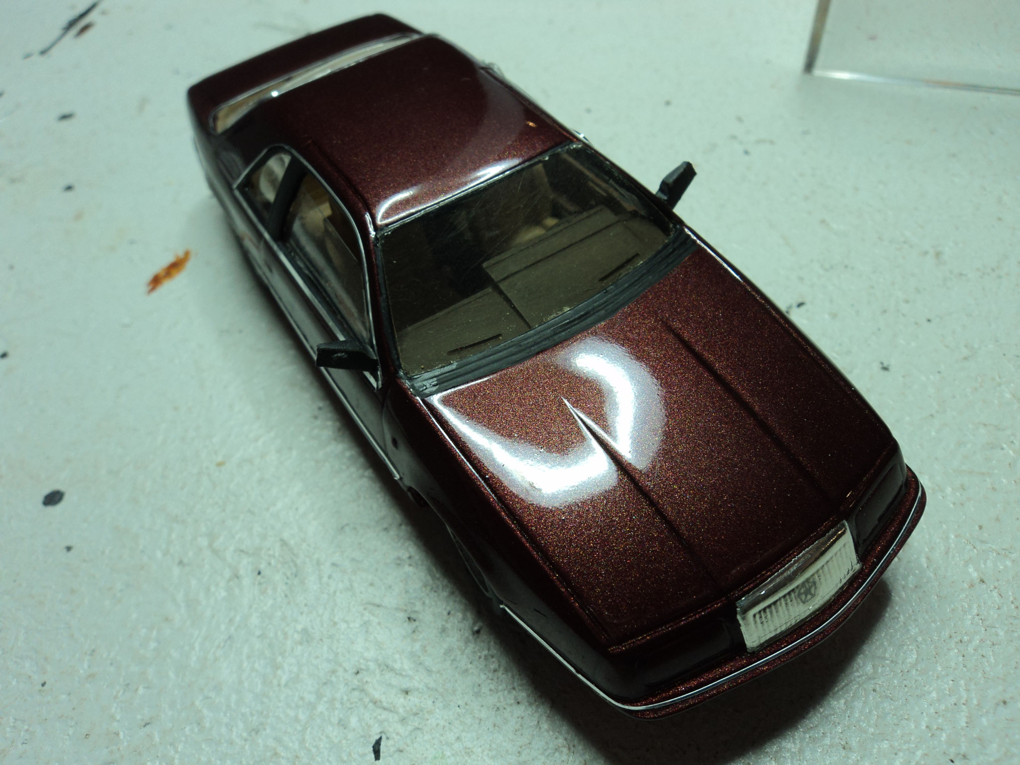 Le Baron Coupé 1993 in burgundy red mét.