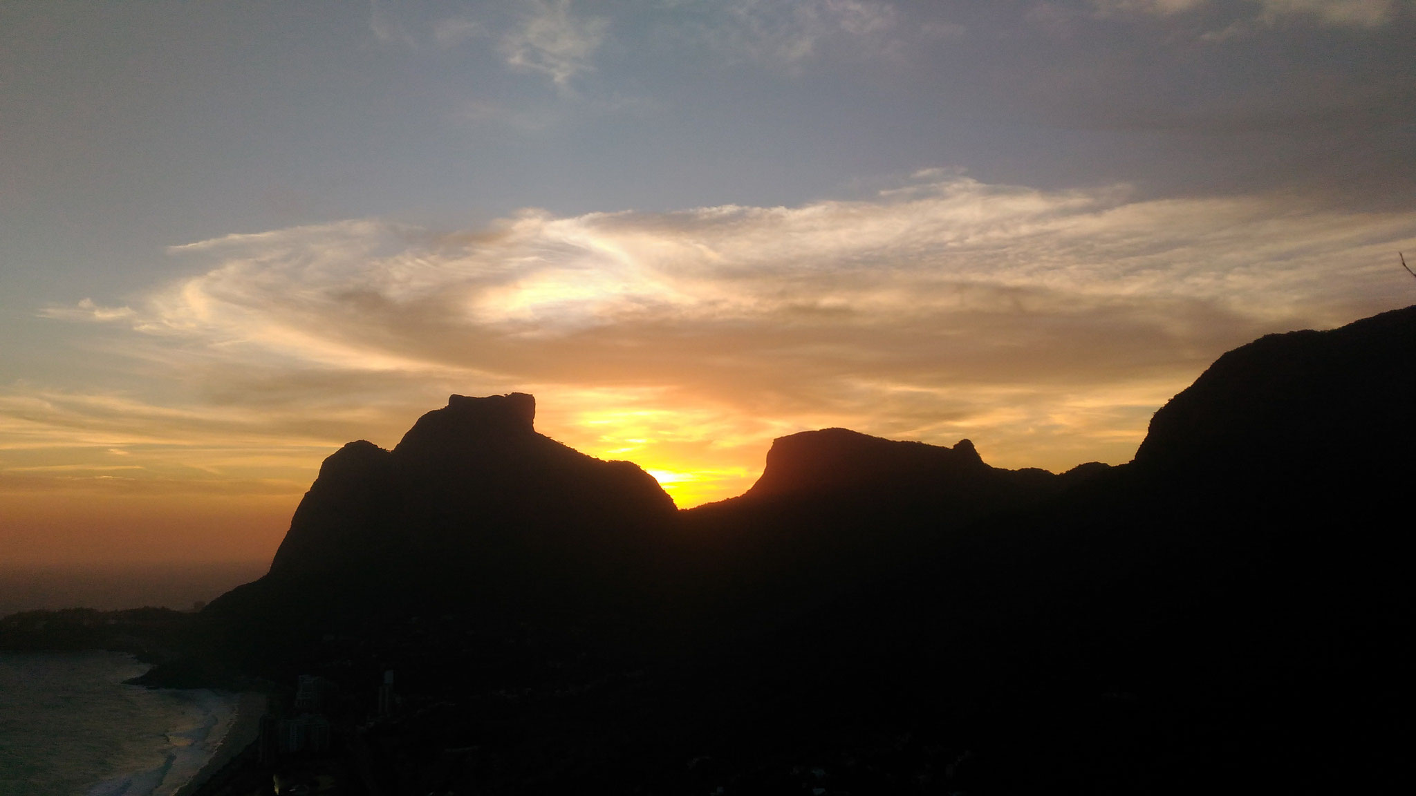sun is setting behing Gavea Peak