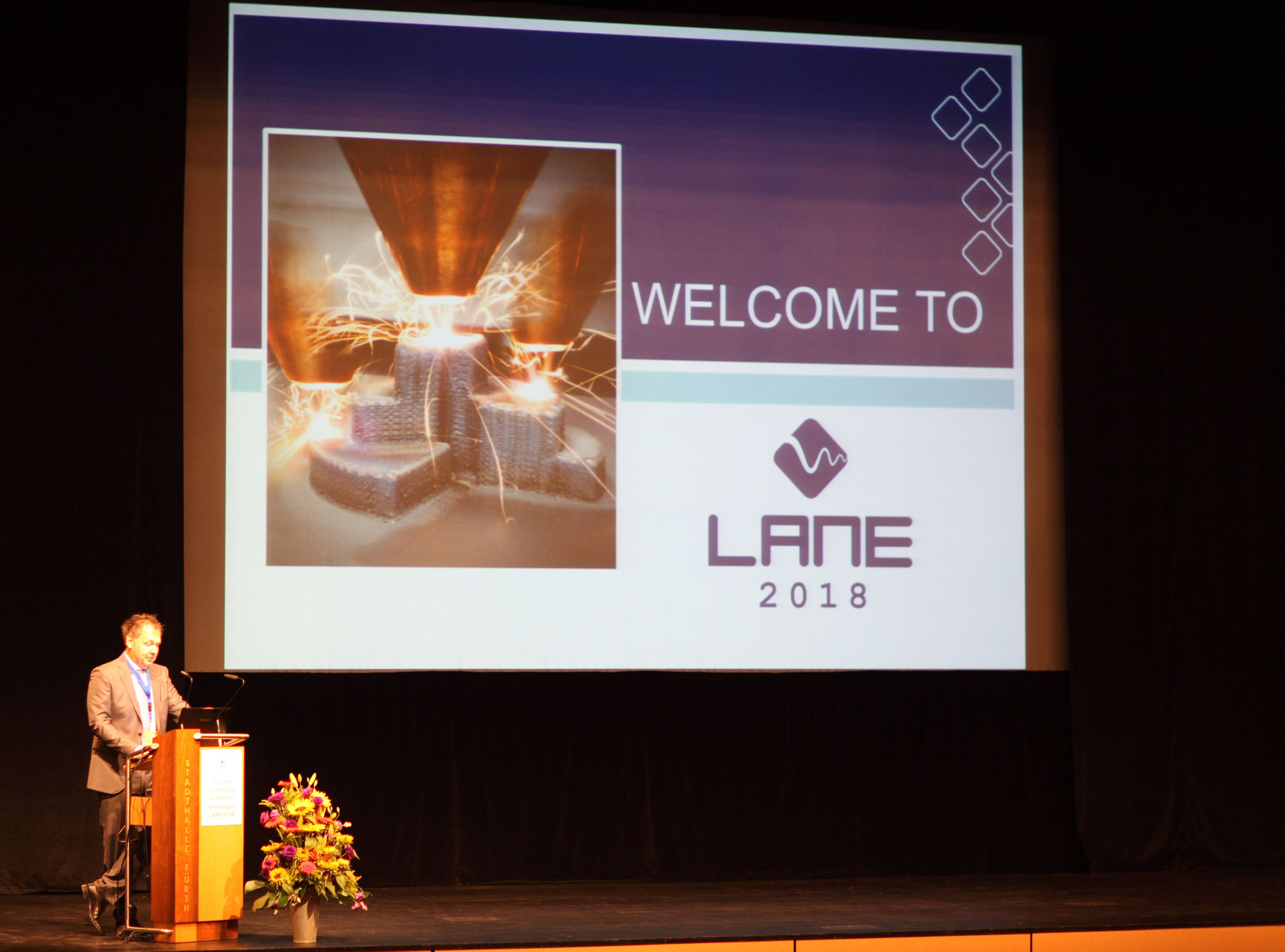 Conference chair Prof. Michael Schmidt is giving his LANE 2018 welcoming speech