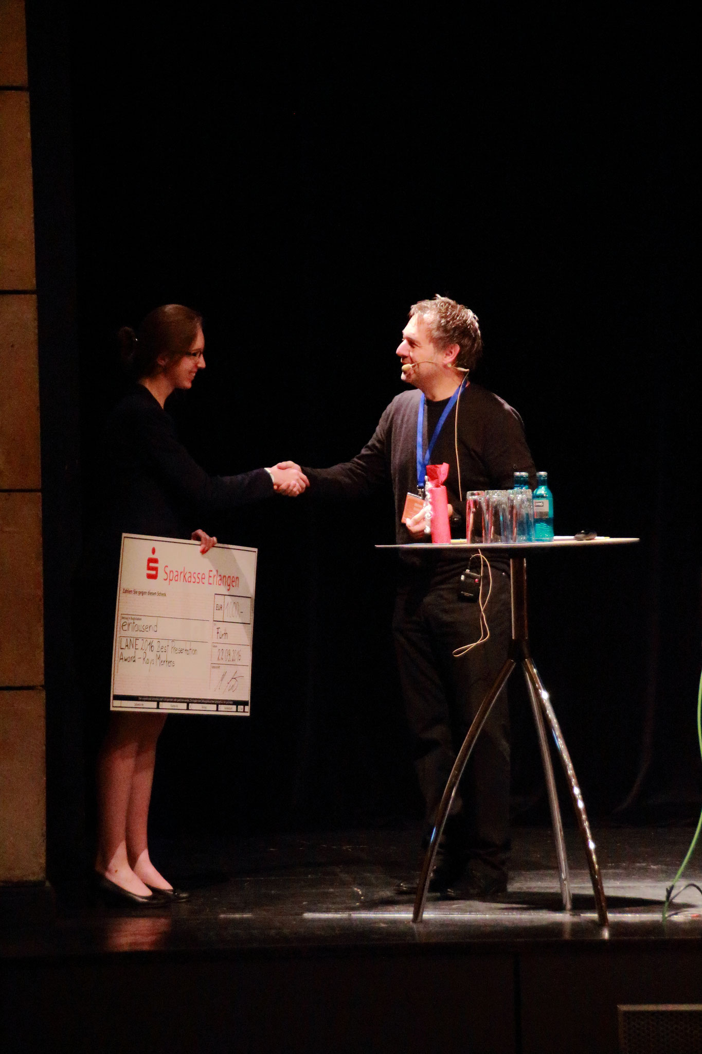 Prof. Michael Schmidt congratulates Raya Mertens (KU Leuven, Belgium) on winning the LANE 2016 Best Presentation Award