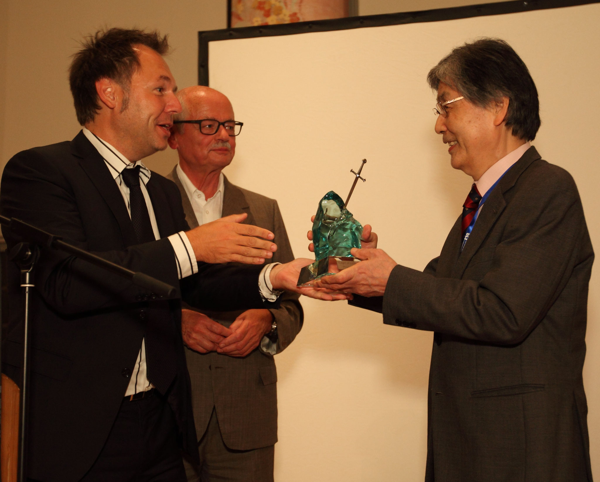 """Conference chair Prof. Michael Schmidt, """"old"""" Knight of Laser Technology Prof. Manfred Geiger and """"new"""" Knight of Laser Technology Prof. Isamu Miyamoto during the Conference Banquet  in 2014 (from left to right)"""