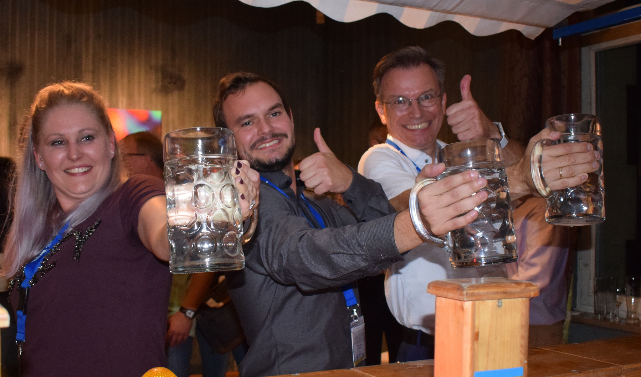 LANE participants playing beer stein holding at the Casual Reception & Bavarian Evening