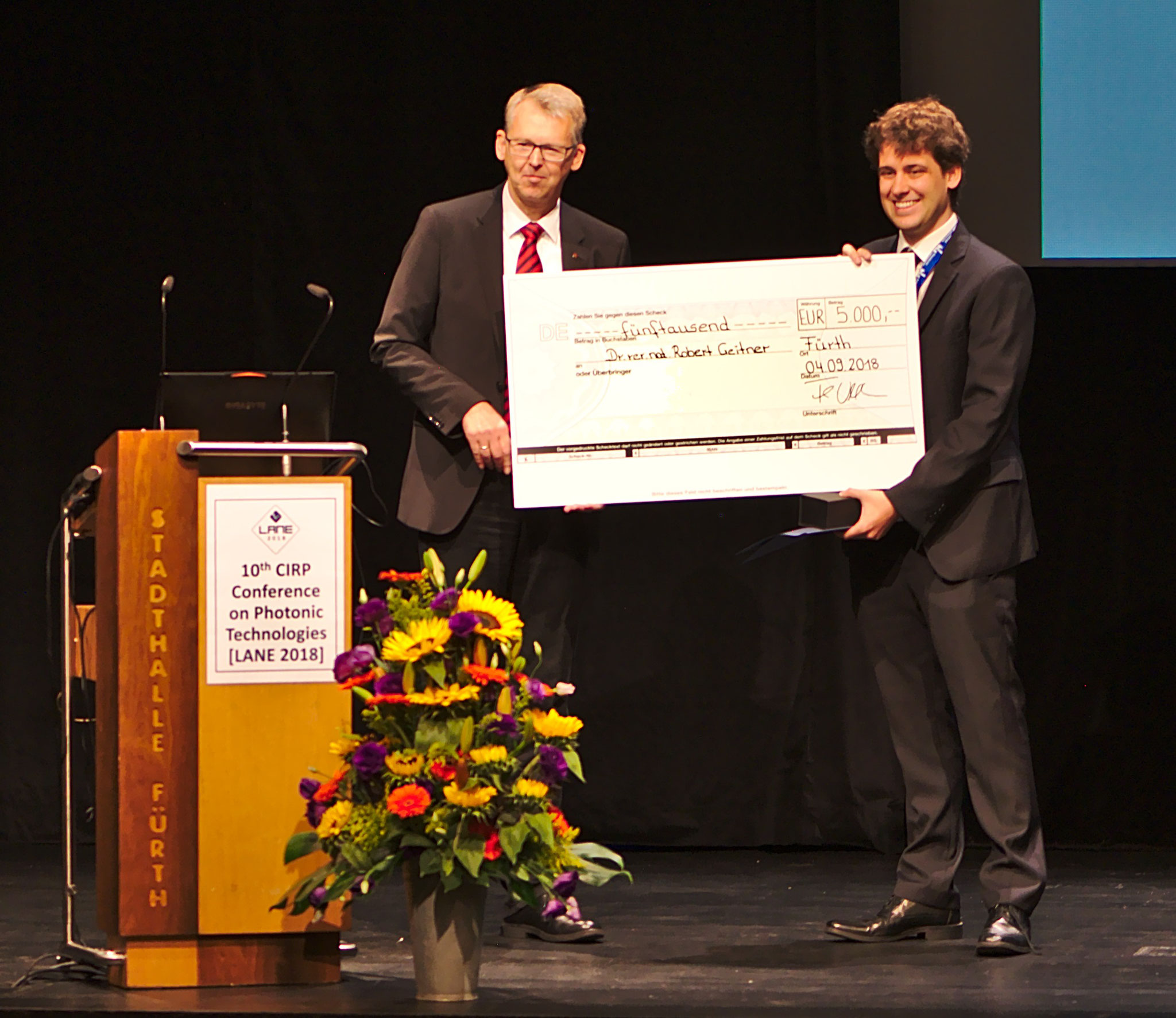 Prof. Frank Vollertsen from BIAS – Bremer Institut für angewandte Strahltechnik GmbH (left) and Dr. Robert Geitner from Utrecht University (right) during the ceremony for the Award of the Scientific Society for Laser Technology (WLT e.V.)