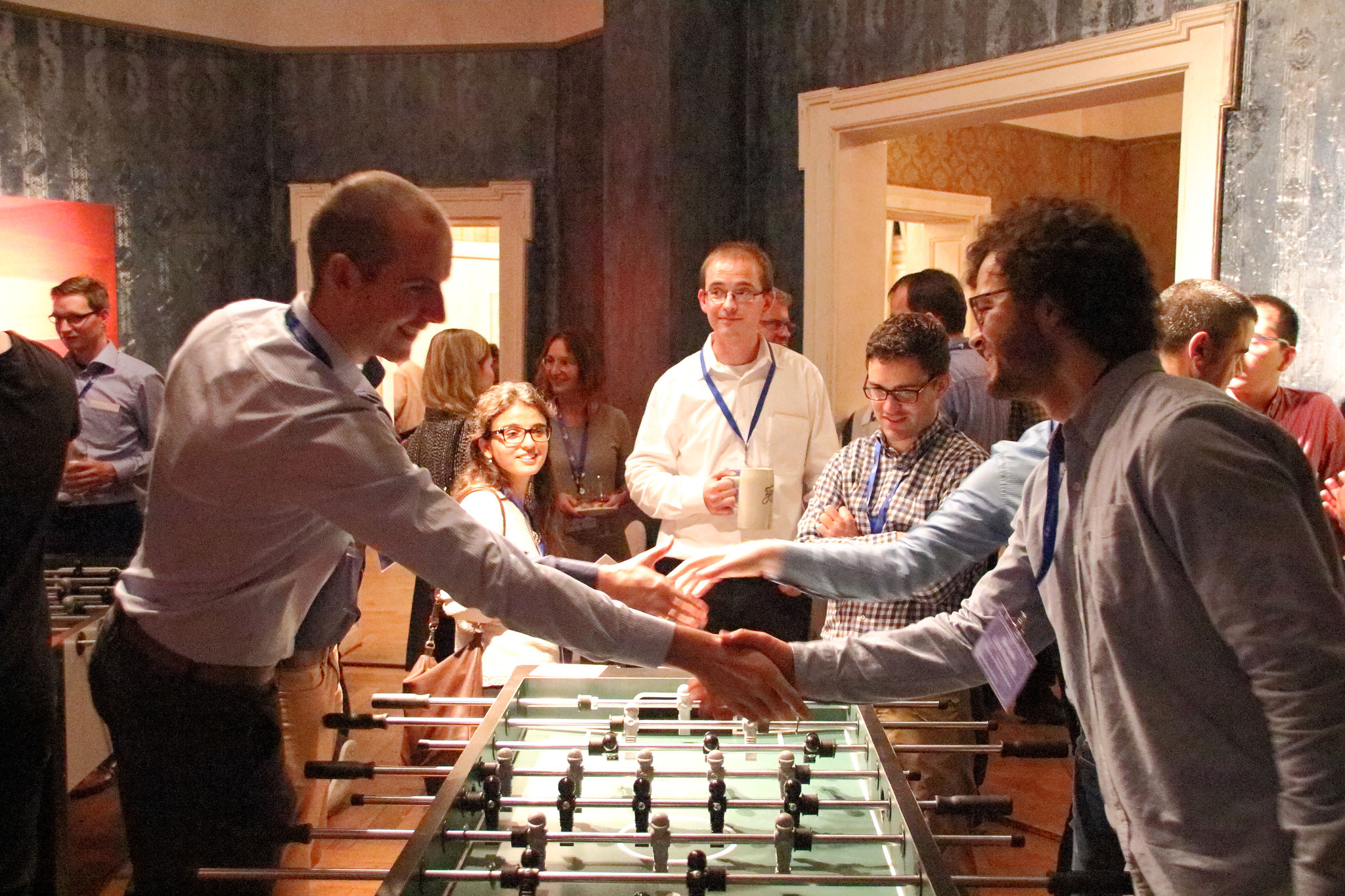 LANE participants playing a game of tabletop football at the Photonics Pub Games Night during the Casual Reception of LANE 2016