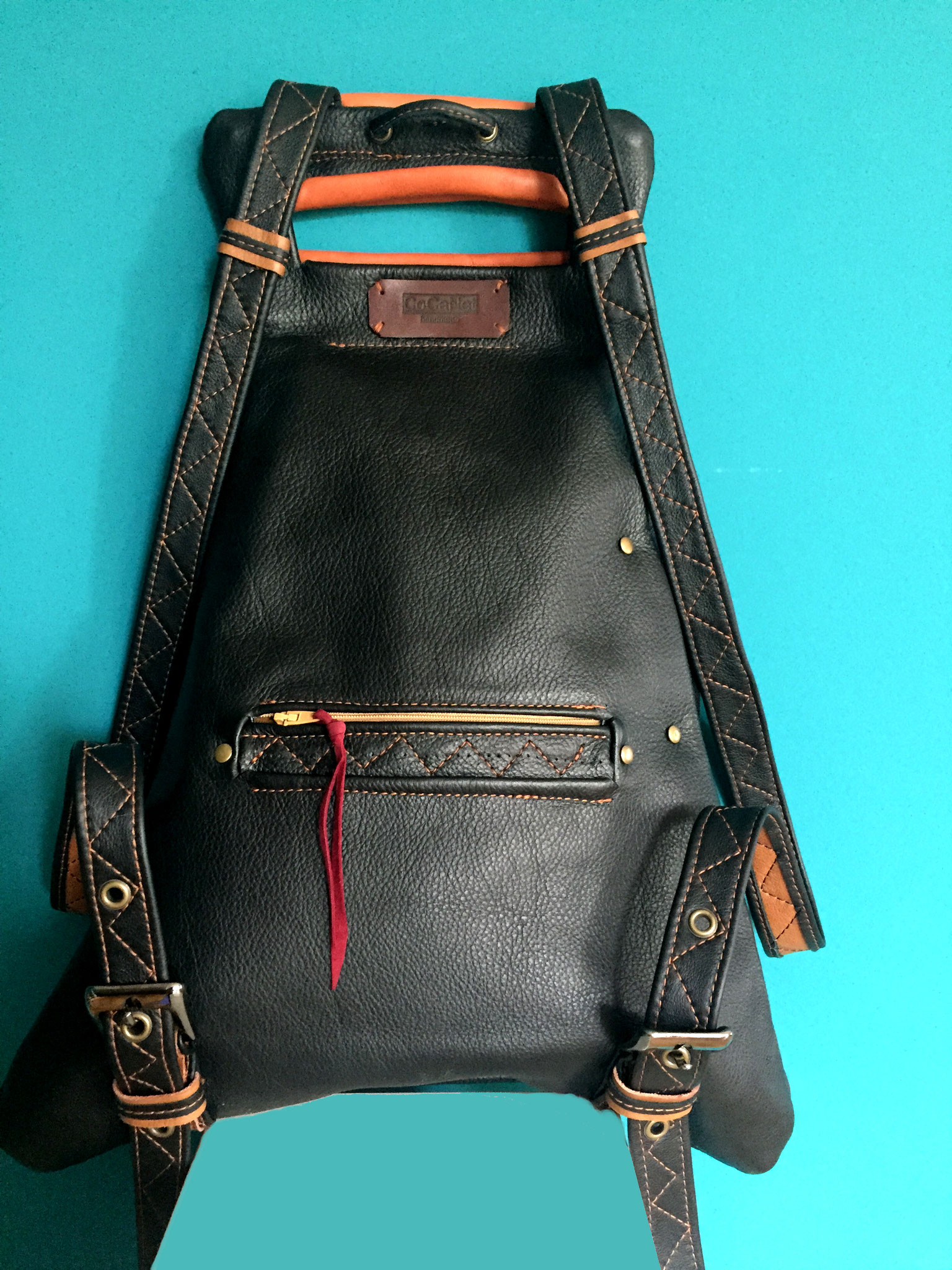 Lederrucksack schwarz braun. Aussentasche