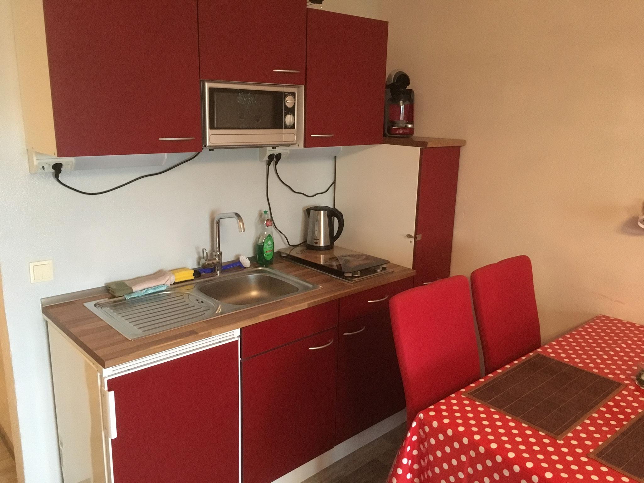 Schlafraum mit Küche und Sitzecke