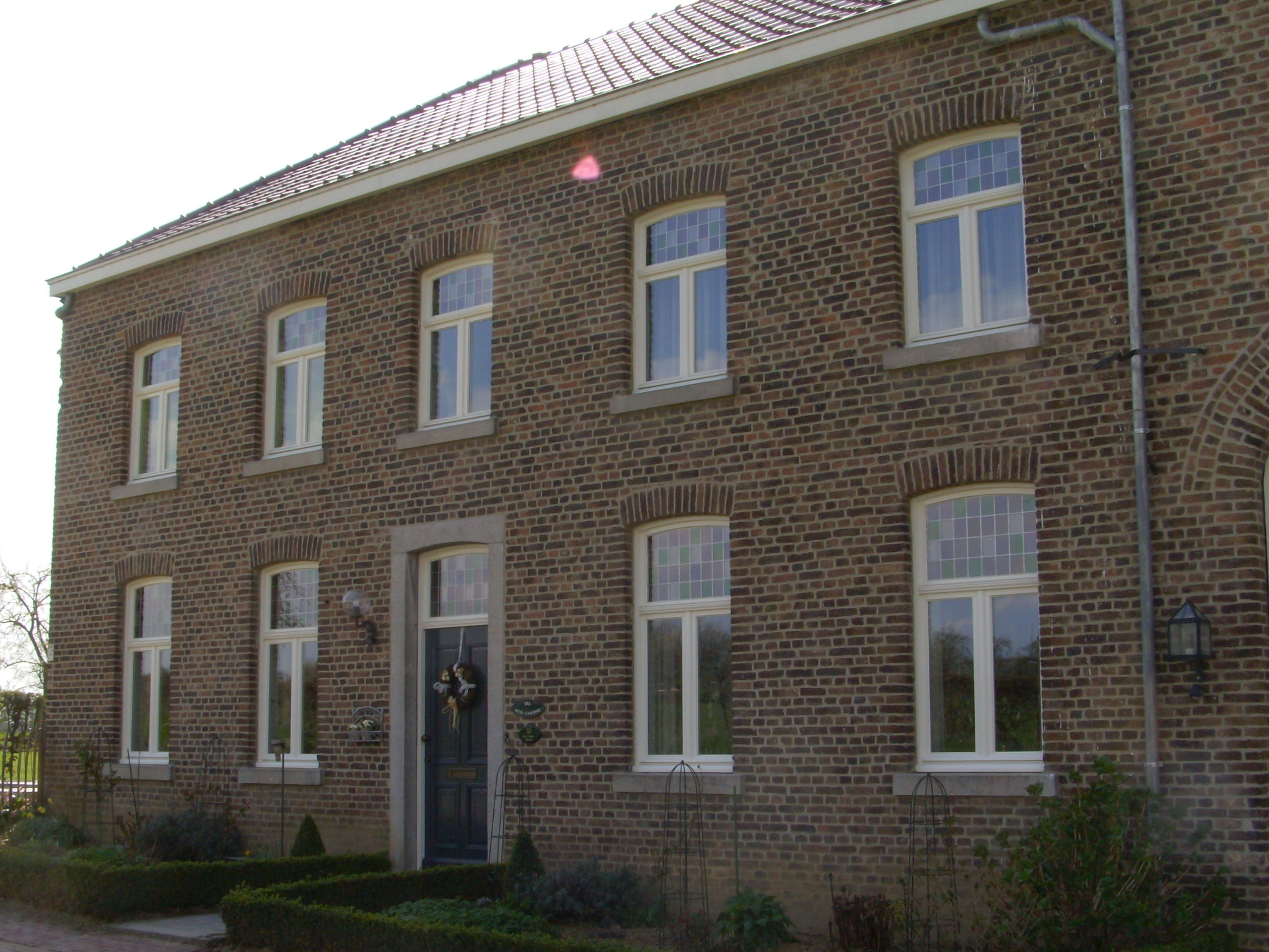 houten ramen en voordeur in Moerslag
