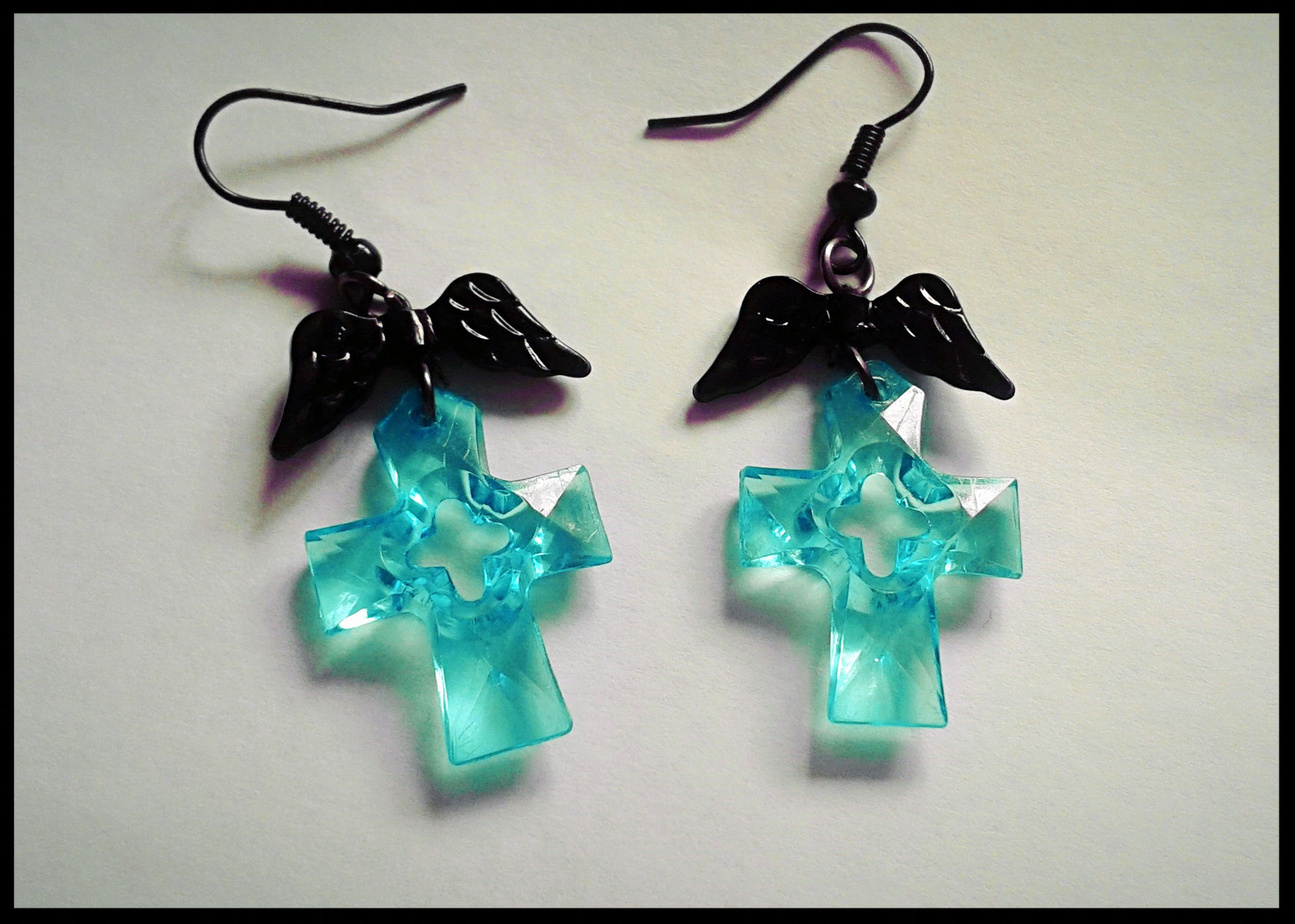 Translucent Aqua Cross Earrings with Black Wings
